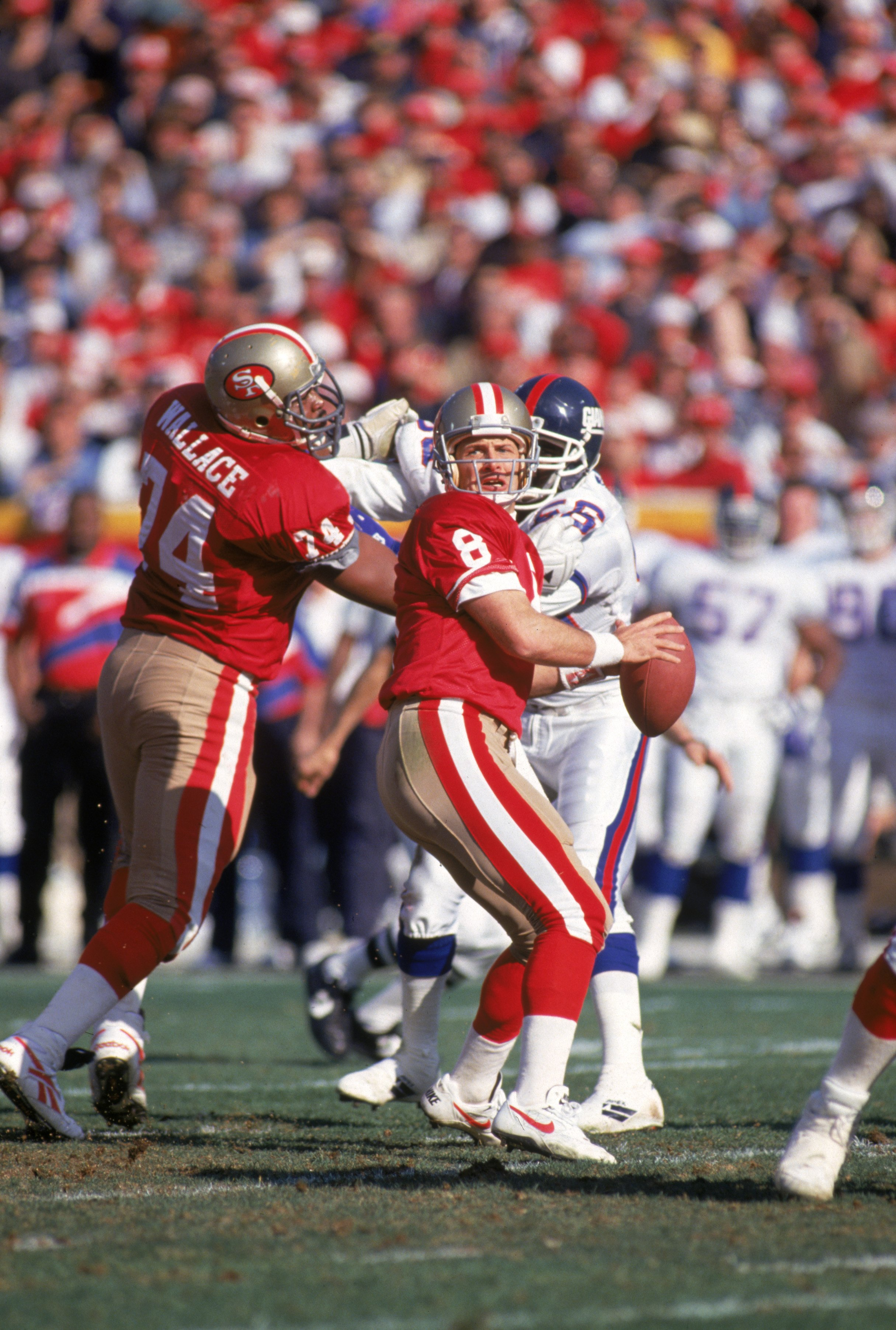 SAN FRANCISCO - JANUARY 15:  Quarterback Steve Young #8 of the San Francisco 49ers drops back to pass during the 1993 NFC Divisional Playoff game against the New York Giants at Candlestick Park on January 15, 1994 in San Francisco, California.  The 49ers