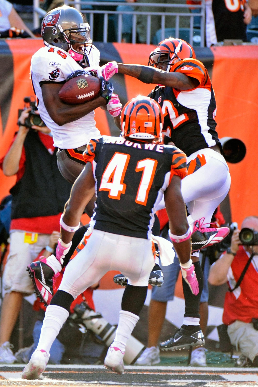 CINCINNATI, OH - OCTOBER 10:  Mike Williams #19 of the Tampa Bay Buccaneers makes a 20-yard touchdown reception as Johnathan Joseph #22 and Chinedum Ndukwe #41 of the Cincinnati Bengals defend at Paul Brown Stadium on October 10, 2010 in Cincinnati, Ohio.