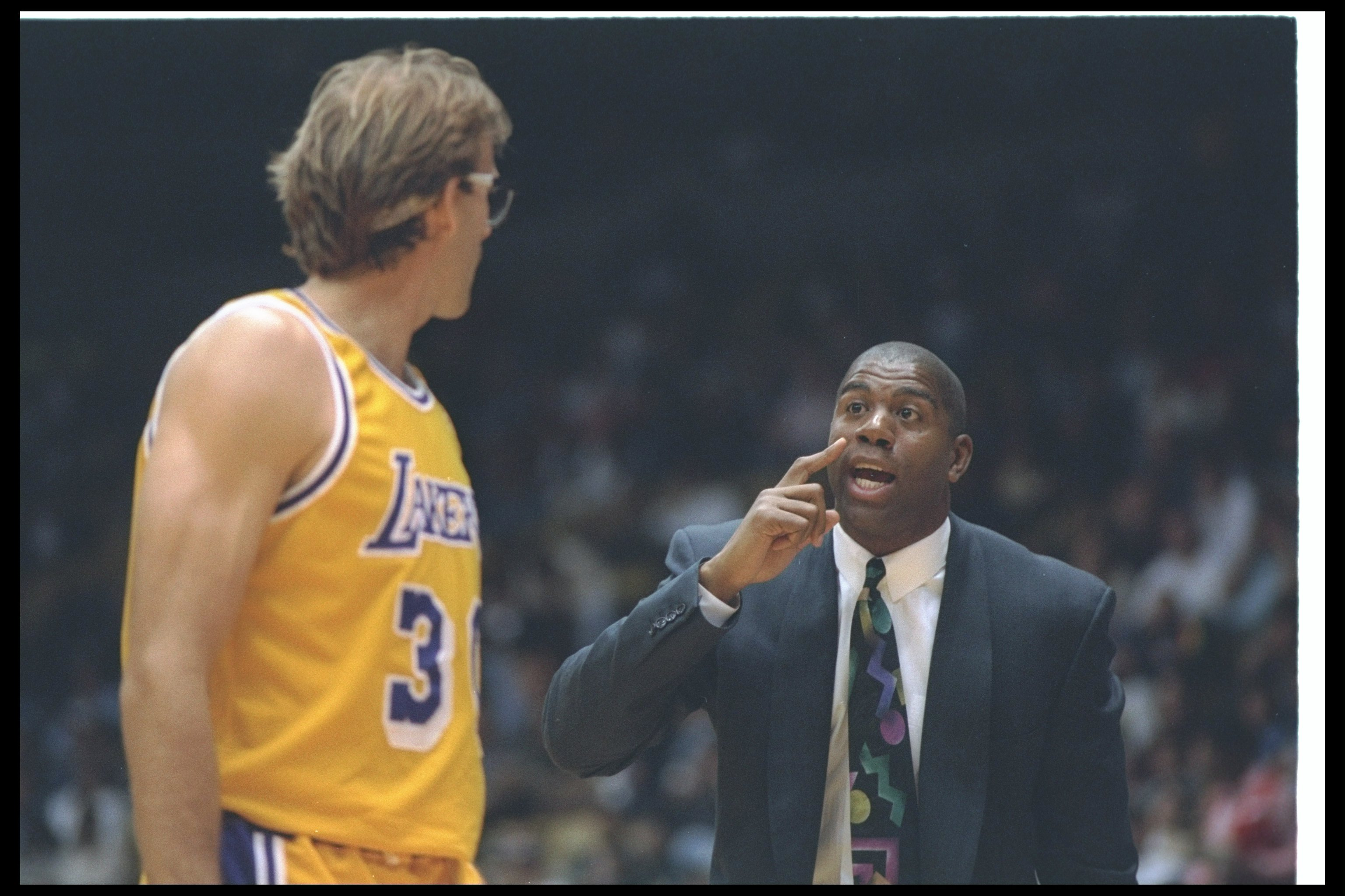 29 Mar 1994:  Los Angeles Lakers head coach Magic Johnson confers with Kurt Rambis during a game against the Minnesota Timberwolves at the Great Western Forum in Inglewood, California. Mandatory Credit: Stephen Dunn  /Allsport Mandatory Credit: Stephen Du