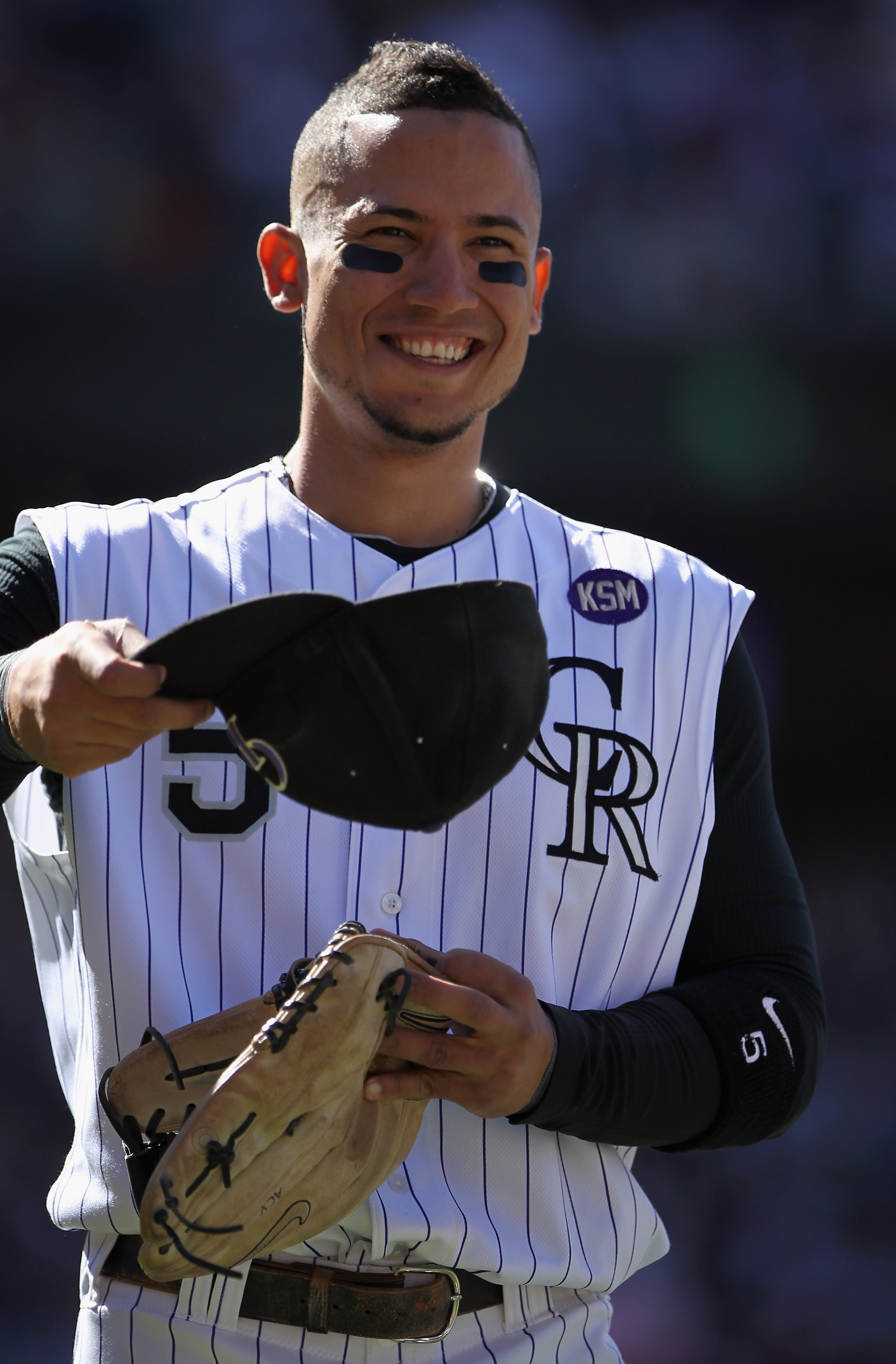 DENVER - SEPTEMBER 06:  Carlos Gonzalez #5 of the Colorado Rockies looks on as he takes the field against the Cincinnati Reds at Coors Field on September 6, 2010 in Denver, Colorado. Gonzalez went 3 for 5 and increased his average to .340 as the Rockies d