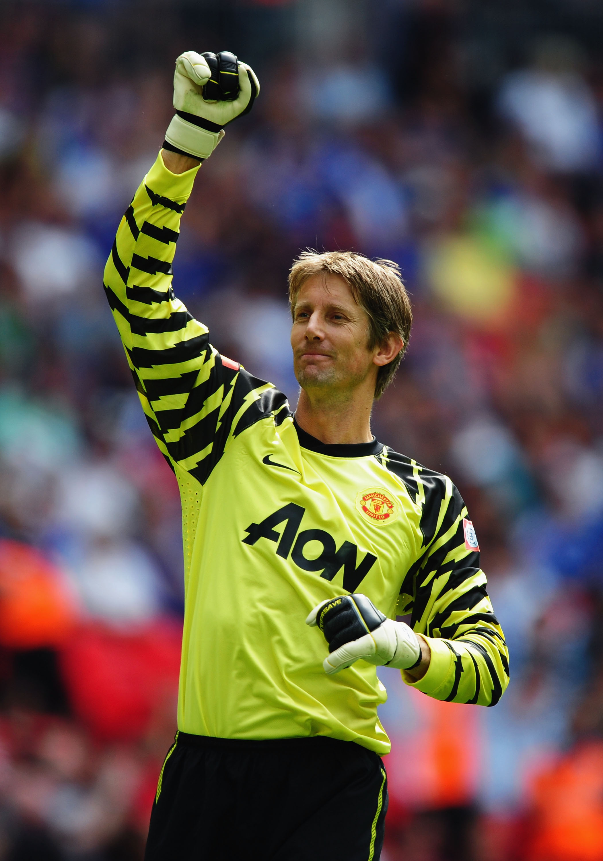 LONDON, ENGLAND - AUGUST 08:  Edwin Van der Sar of Manchester United celebrates the opening goal by Antonio Valencia during the FA Community Shield match between Chelsea and Manchester United at Wembley Stadium on August 8, 2010 in London, England.  (Phot