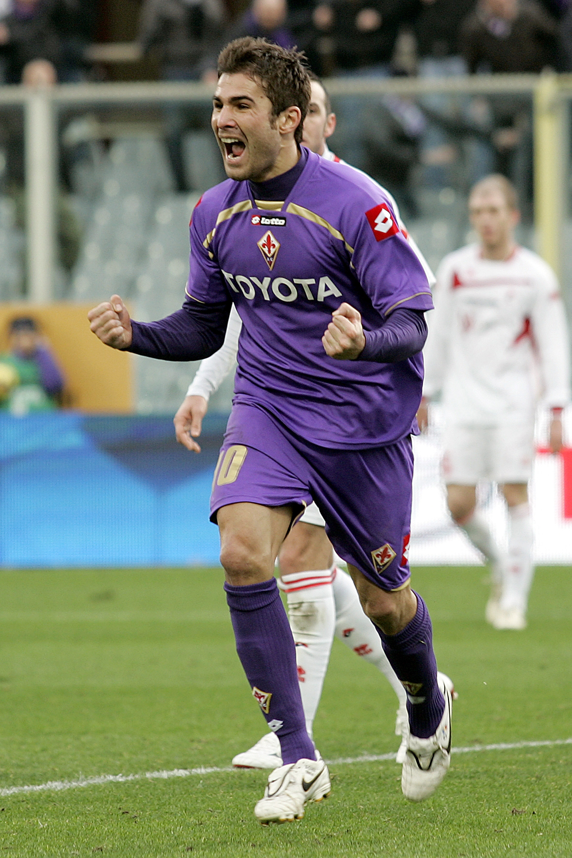 FLORENCE, ITALY - JANUARY 10:  Adrian Mutu of ACF Fiorentina celebrates after scoring a goal during the Serie A match between Fiorentina and Bari at Stadio Artemio Franchi on January 10, 2010 in Florence, Italy.  (Photo by Gabriele Maltinti/Getty Images)