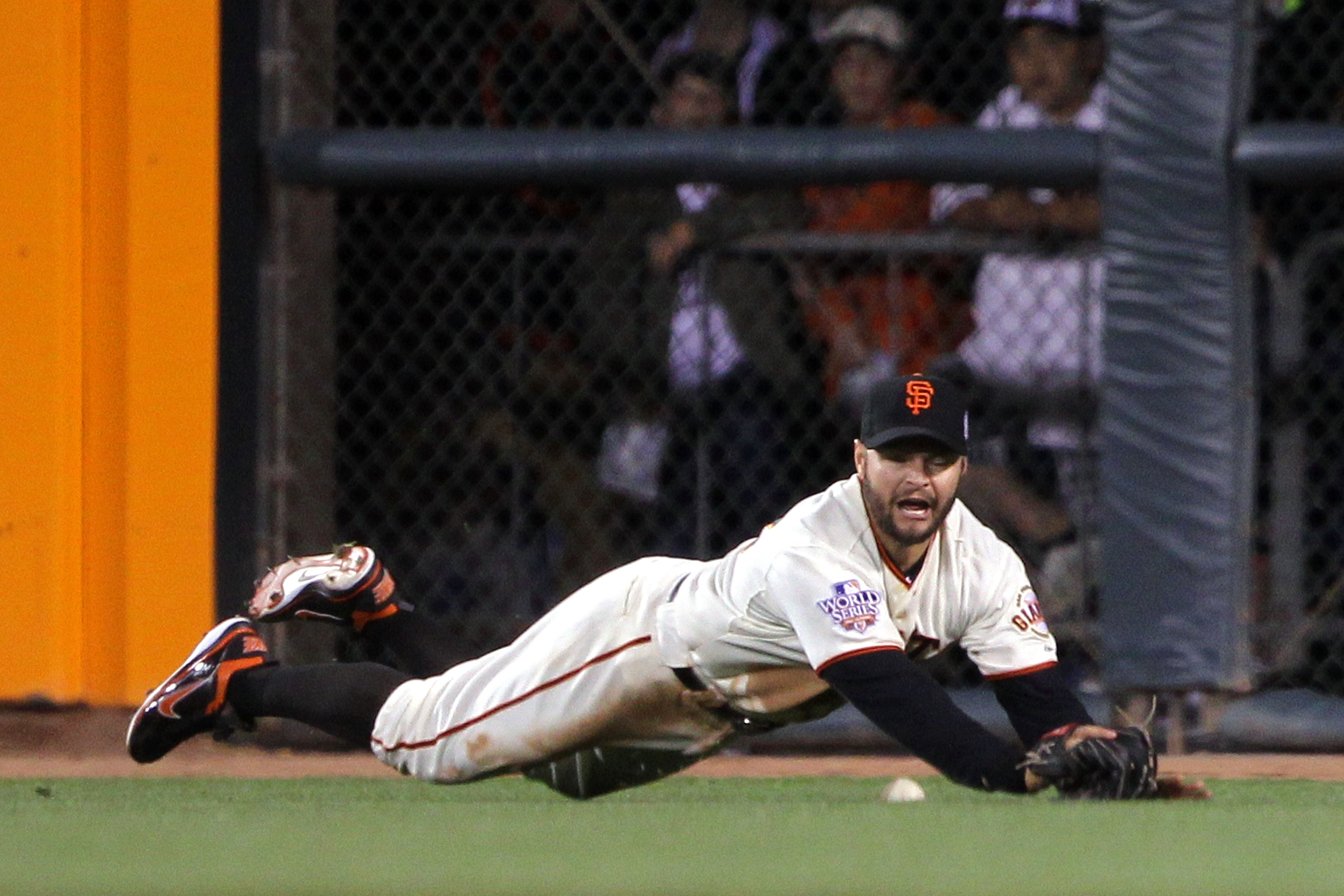 SAN FRANCISCO - OCTOBER 28:  Cody Ross #13 of the San Francisco Giants is unable to catch a ball hit by Josh Hamilton #32 of the Texas Rangers leading to single for Hamilton in the sixth inning of Game Two of the 2010 MLB World Series at AT&T Park on Octo