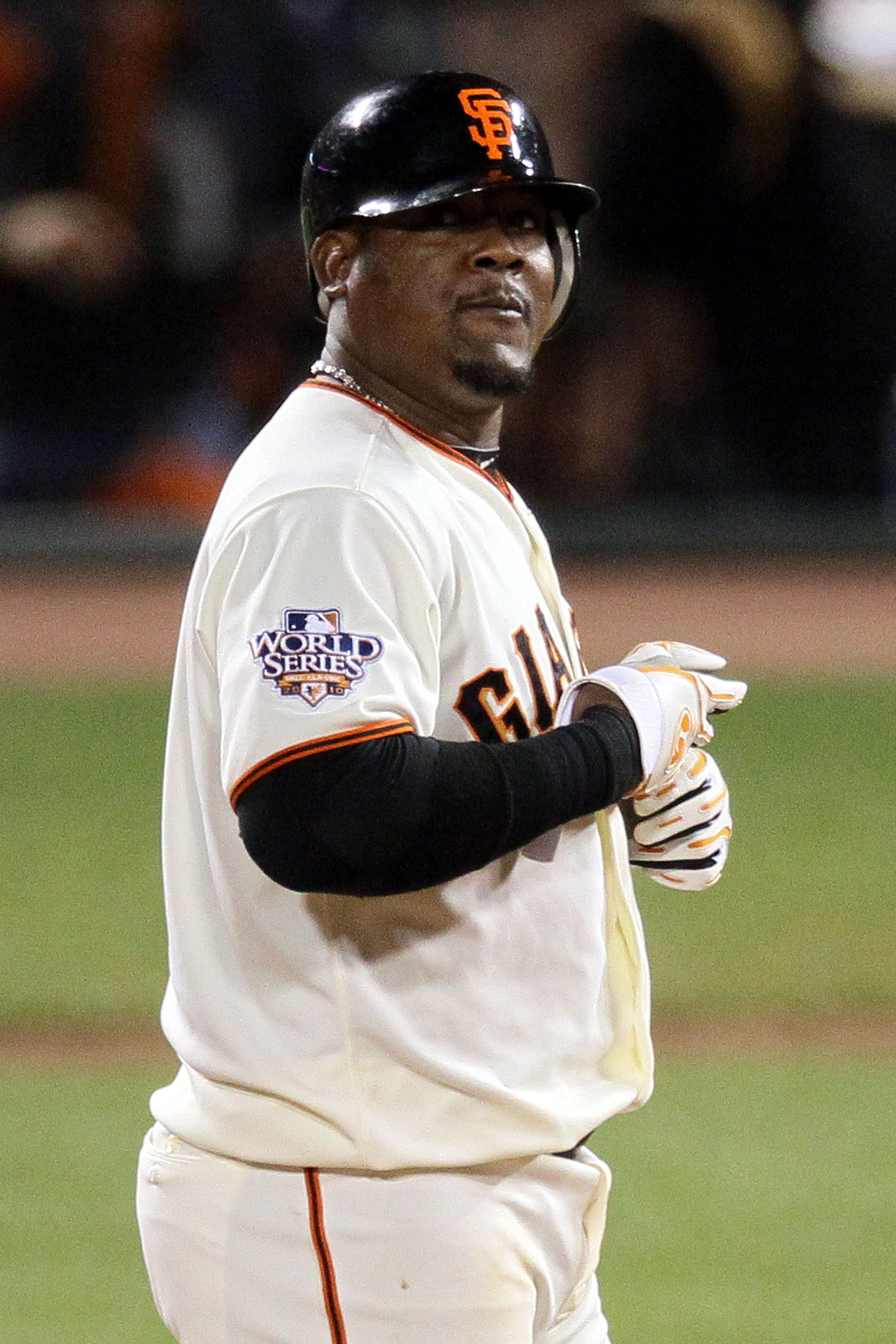 SAN FRANCISCO - OCTOBER 28:  Juan Uribe #5 of the San Francisco Giants reacts after hits a RBI double in the seventh inning off Darren Oliver #28 of the Texas Rangers in Game Two of the 2010 MLB World Series at AT&T Park on October 28, 2010 in San Francis