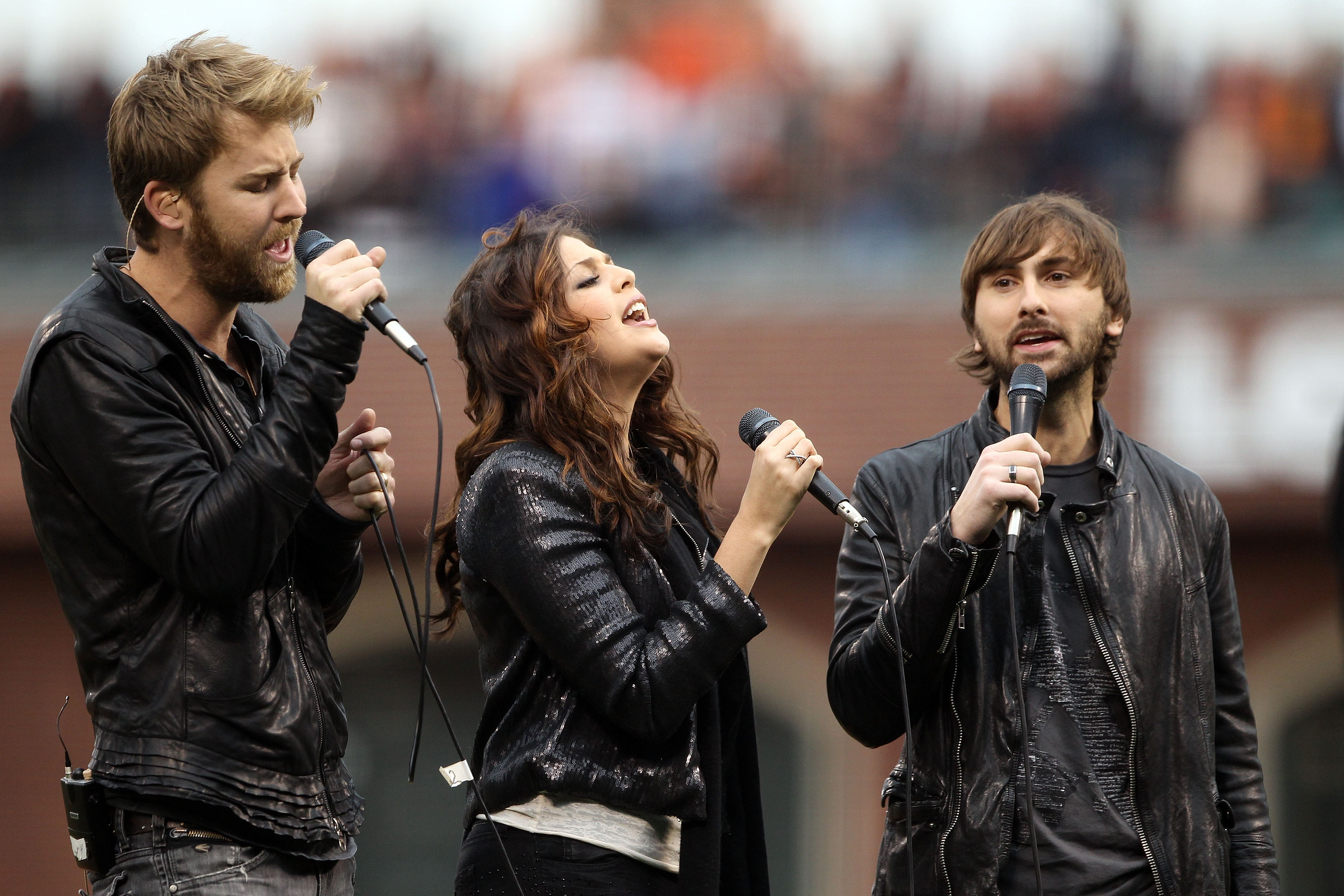 SAN FRANCISCO - OCTOBER 28:  Charles Kelly (L), Hillary Scott and Dave Haywood (R) of Lady Antebellum sing the national anthem before the start of Game Two of the 2010 MLB World Series between the San Francisco Giants and Texas Rangers on October 28, 2010