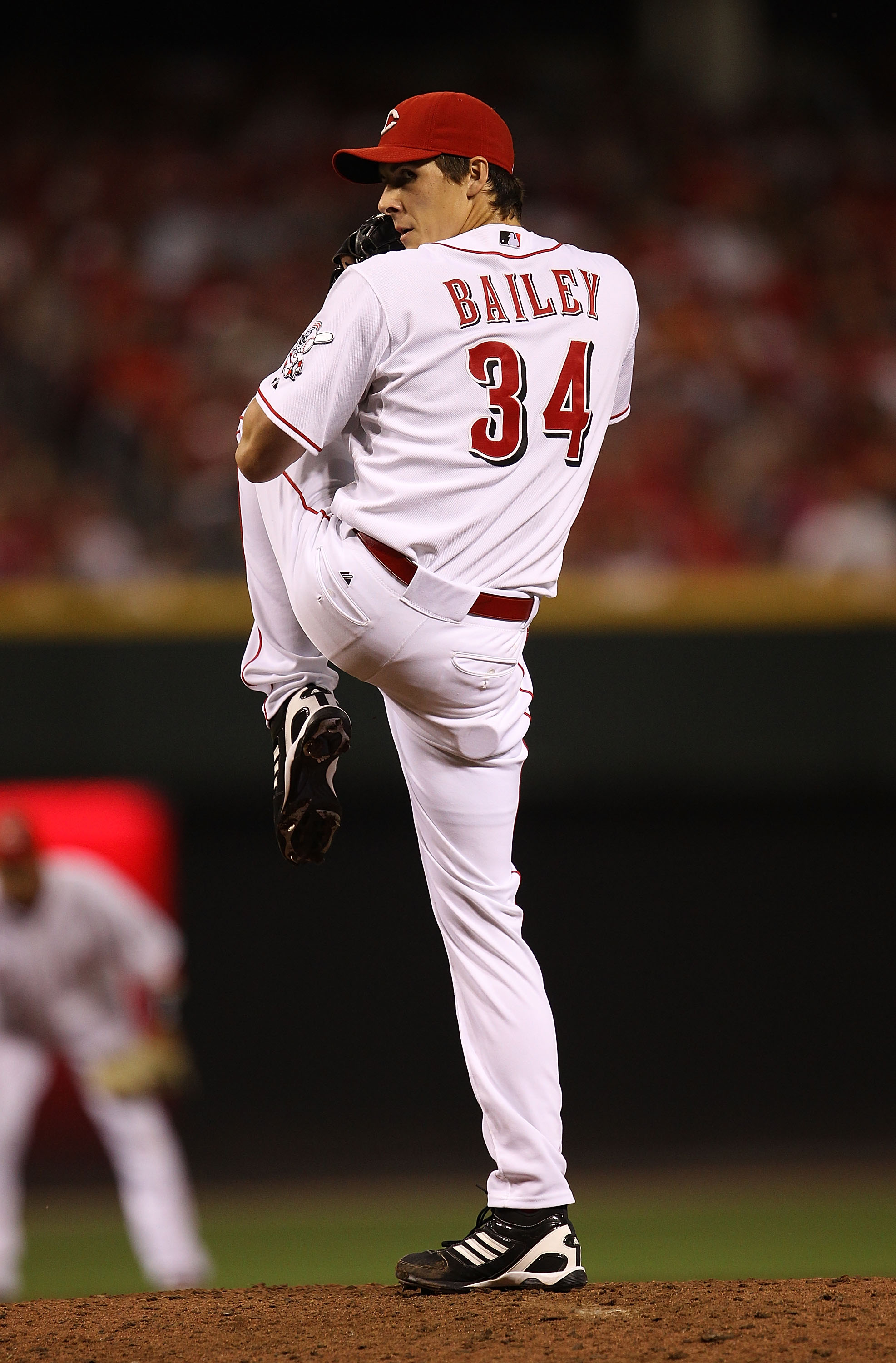 CINCINNATI - OCTOBER 10: Homer Bailey #34 of the Cincinnati Reds pitches against the Philadelphia Phillies during game 3 of the NLDS at Great American Ball Park on October 10, 2010 in Cincinnati, Ohio. The Phillies defeated the Reds 2-0. (Photo by Jonatha