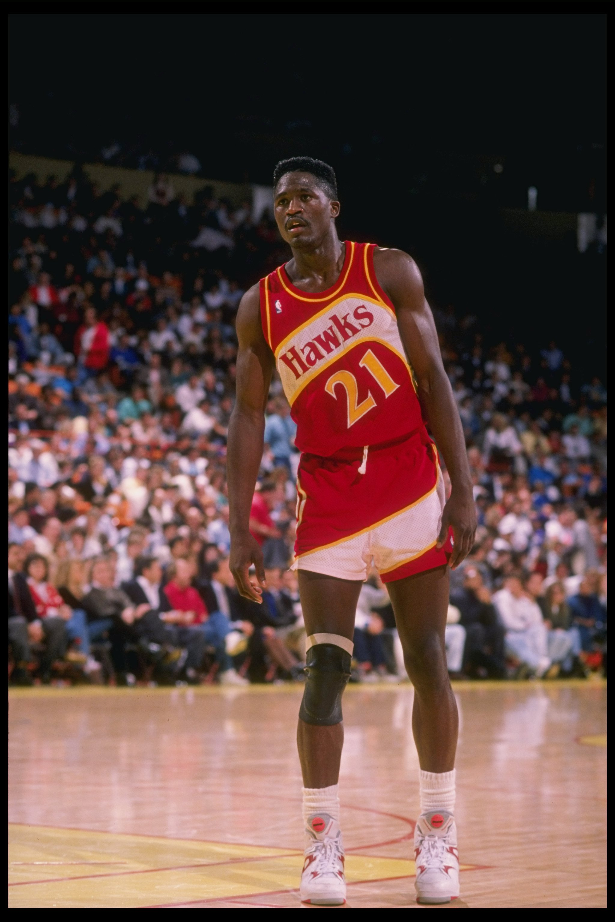 Forward Dominique Wilkins of the Atlanta Hawks stands on the court during a game.