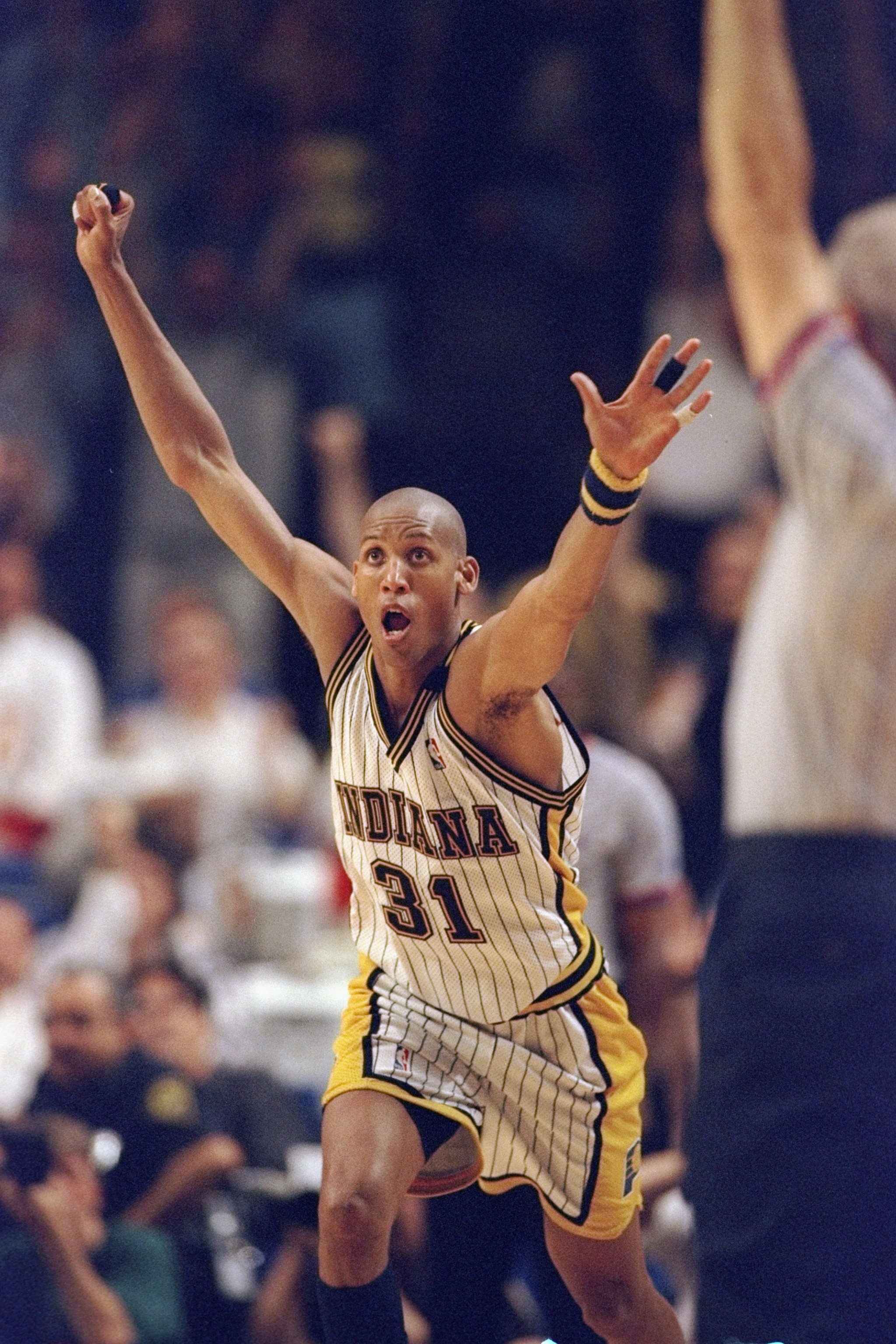 25 May 1998: Reggie Miller #31 of the Indiana Pacers celebrates during an Eastern Conference Final game against the Chicago Bulls at the Market Square Arena in Indianapolis, Indiana. The Pacers defeated the Bulls 96-94.