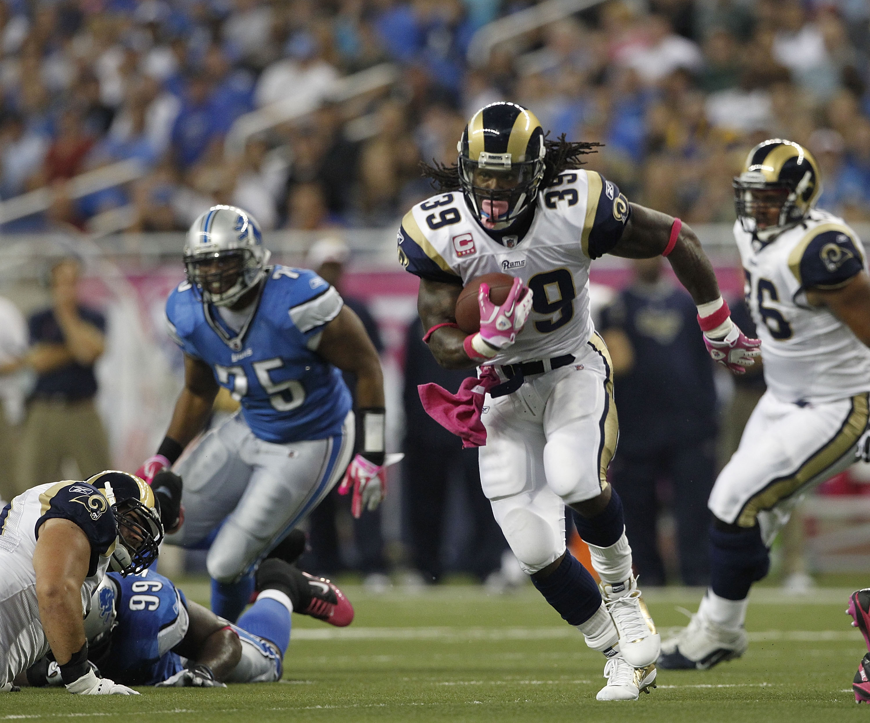 DETROIT - OCTOBER 10: Steven Jackson #39 of the St. Louis Rams runs for a first down during the game against the Detroit Lions at Ford Field on October 10, 2010 in Detroit, Michigan.  (Photo by Leon Halip/Getty Images)