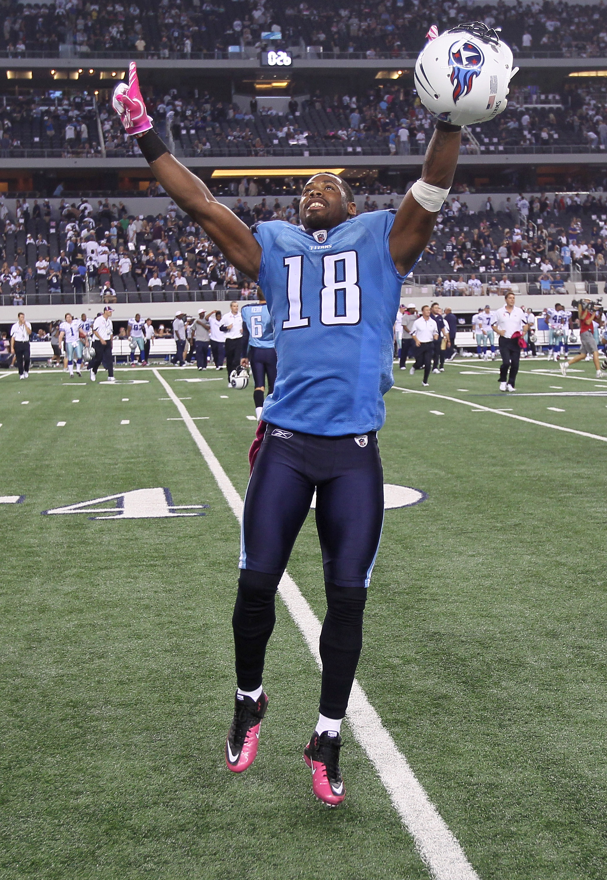 ARLINGTON, TX - OCTOBER 10:  Wide receiver Kenny Britt #18 of the Tennessee Titans celebrates after the game against the Dallas Cowboys at Cowboys Stadium on October 10, 2010 in Arlington, Texas. The Titans won 34-27.  (Photo by Stephen Dunn/Getty Images)
