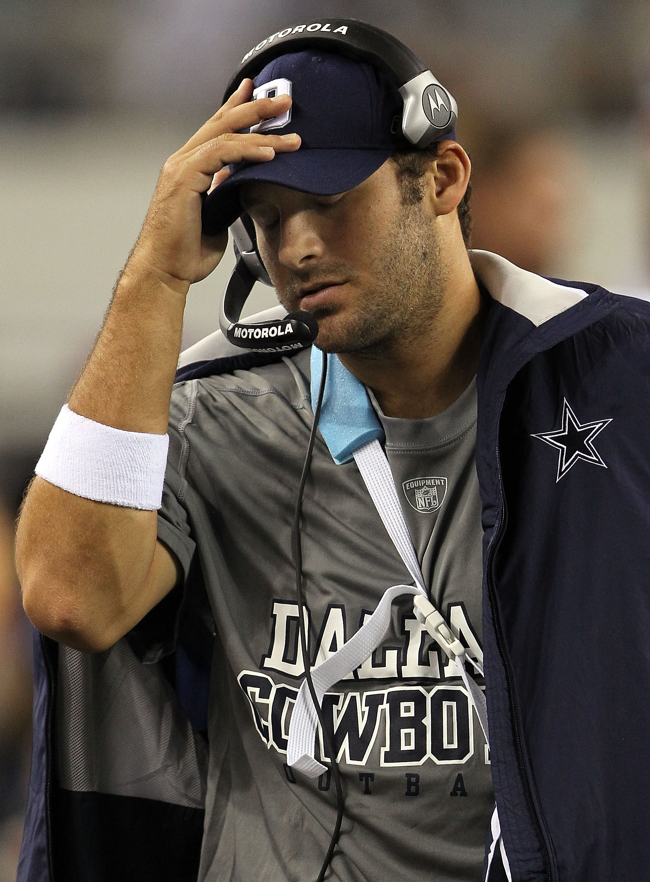 ARLINGTON, TX - OCTOBER 25:  Quarterback Tony Romo #9 of the Dallas Cowboys wears a sling on the sidelines after a left shoulder injury against the New York Giants at Cowboys Stadium on October 25, 2010 in Arlington, Texas.  (Photo by Ronald Martinez/Gett