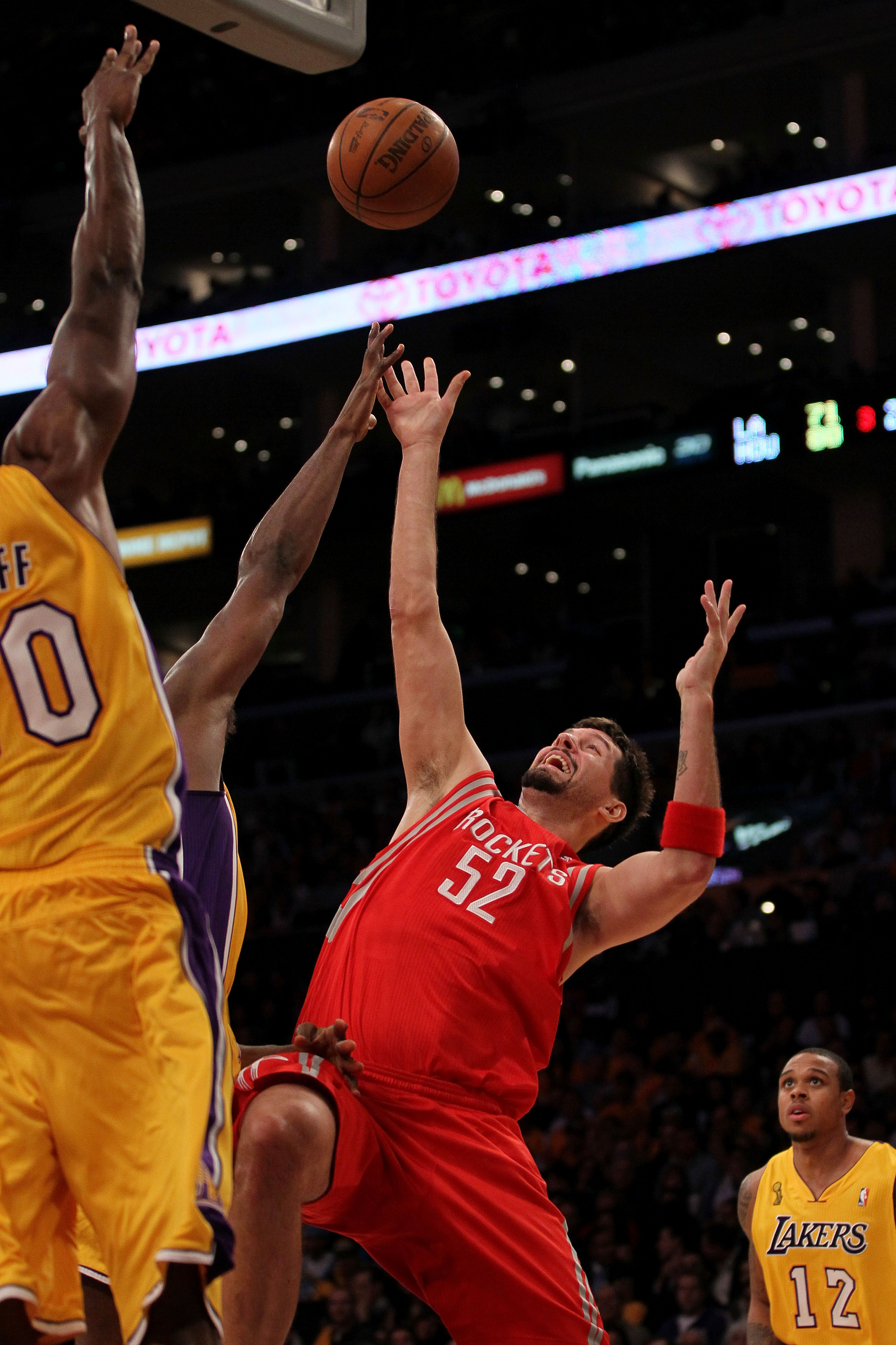 LOS ANGELES, CA - OCTOBER 26:  Brad Miller #52 of the Houston Rockets takes a shot against the Los Angeles Lakers during their game at Staples Center on October 26, 2010 in Los Angeles, California. NOTE TO USER: User expressly acknowledges and agrees that