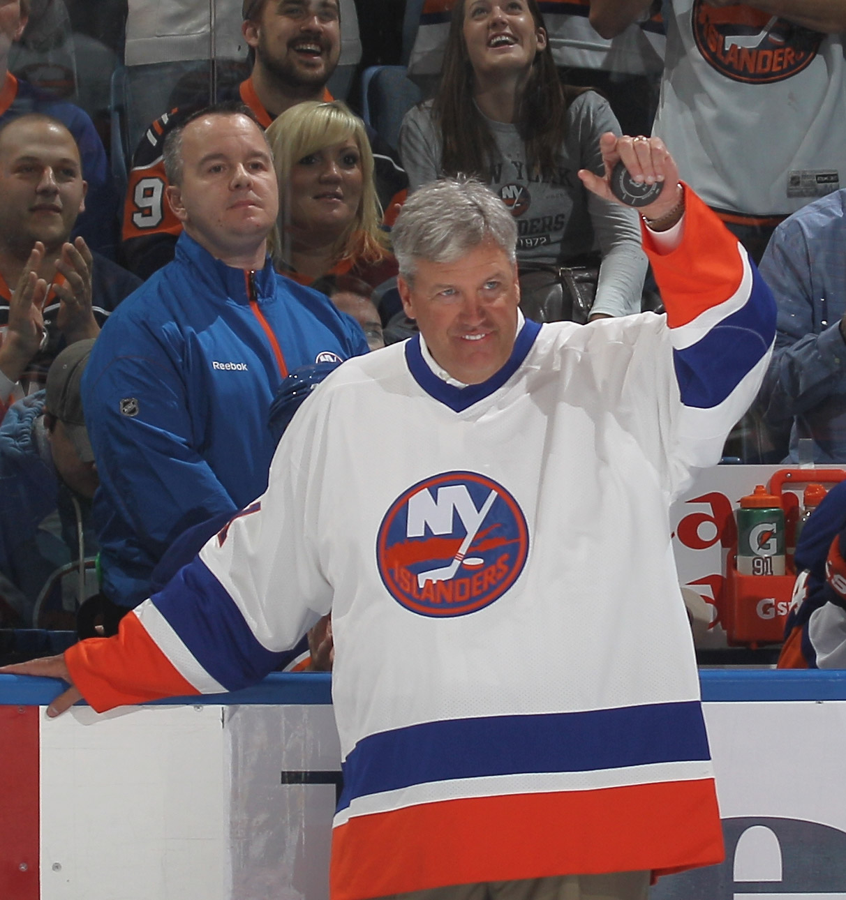UNIONDALE, NY - OCTOBER 09:  New York Jets coach Rex Ryan gets ready to drop the ceremonial puck between Brenden Morrow #10 of the Dallas Stars and Doug Weight #93 of the New York Islanders prior to the Islanders home opener at the Nassau Coliseum on Octo