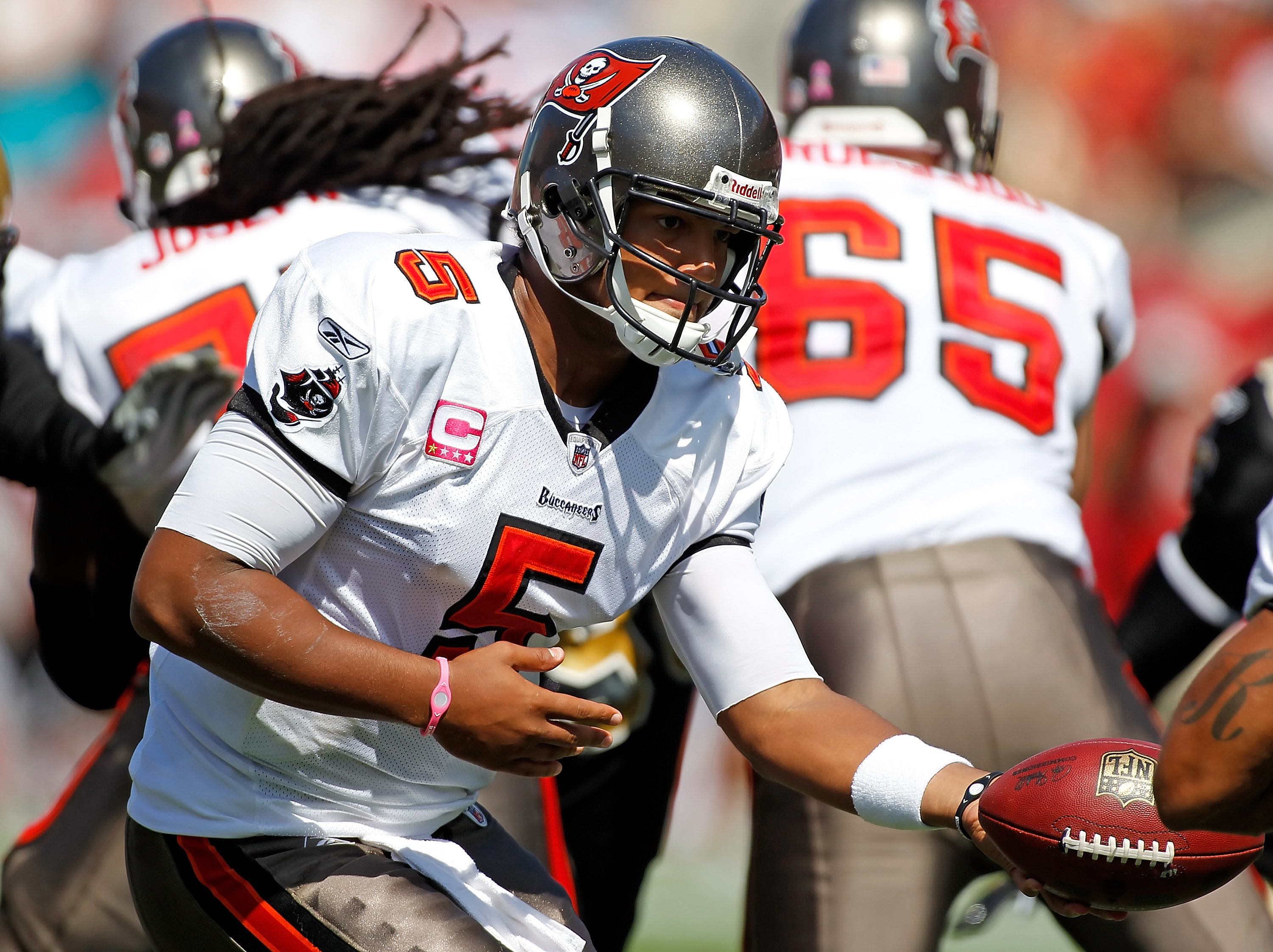 TAMPA, FL - OCTOBER 17:  Quarterback Josh Freeman #5 of the Tampa Bay Buccaneers hands the ball off against the New Orleans Saints during the game at Raymond James Stadium on October 17, 2010 in Tampa, Florida.  (Photo by J. Meric/Getty Images)
