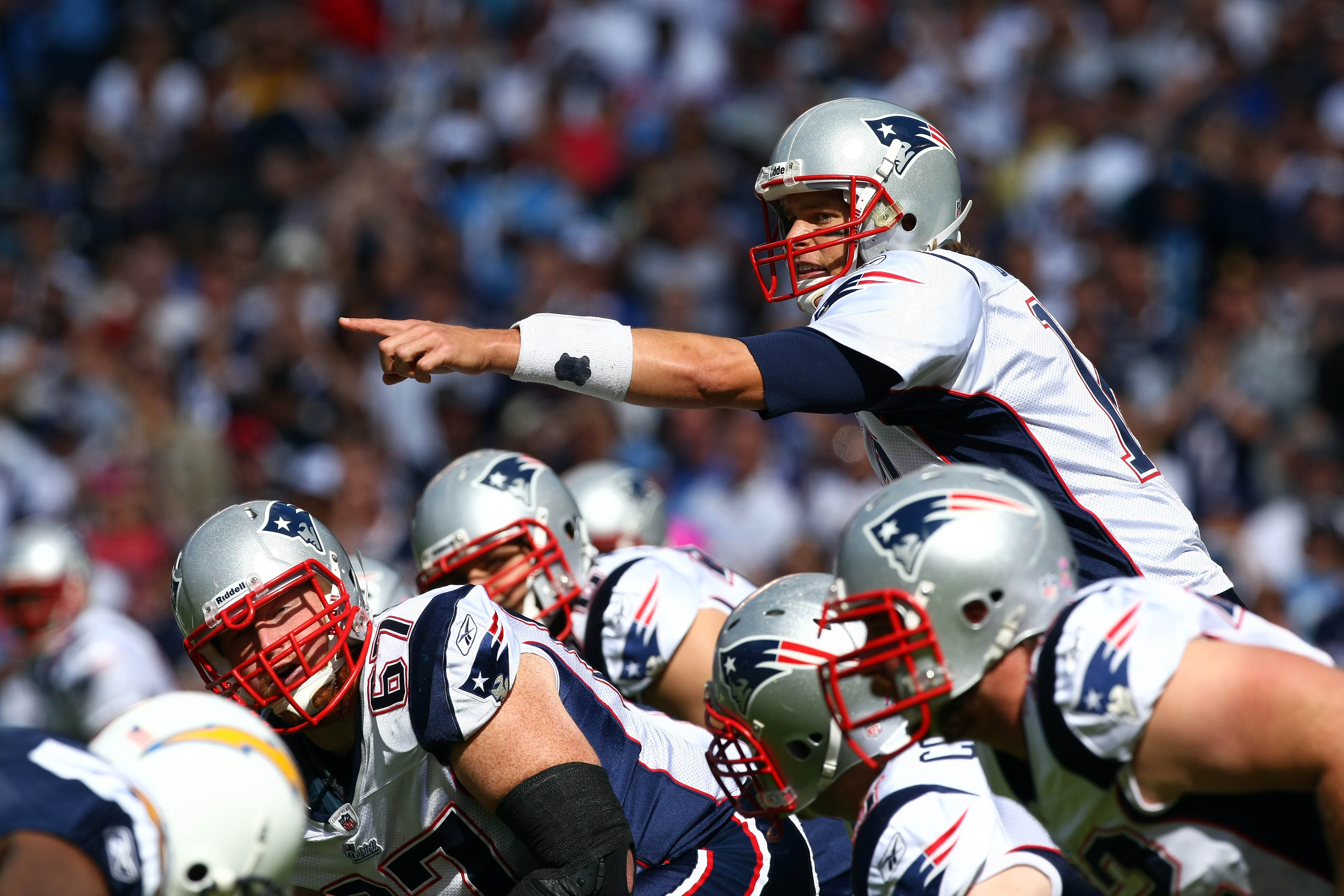 SAN DIEGO - OCTOBER 24:  Quarterback Tom Brady #12 of the New England points at the defense at the line of scrimmage against the San Diego Chargers during their NFL game on October 24, 2010 at Qualcomm Stadium in San Diego, California. (Photo by Donald Mi