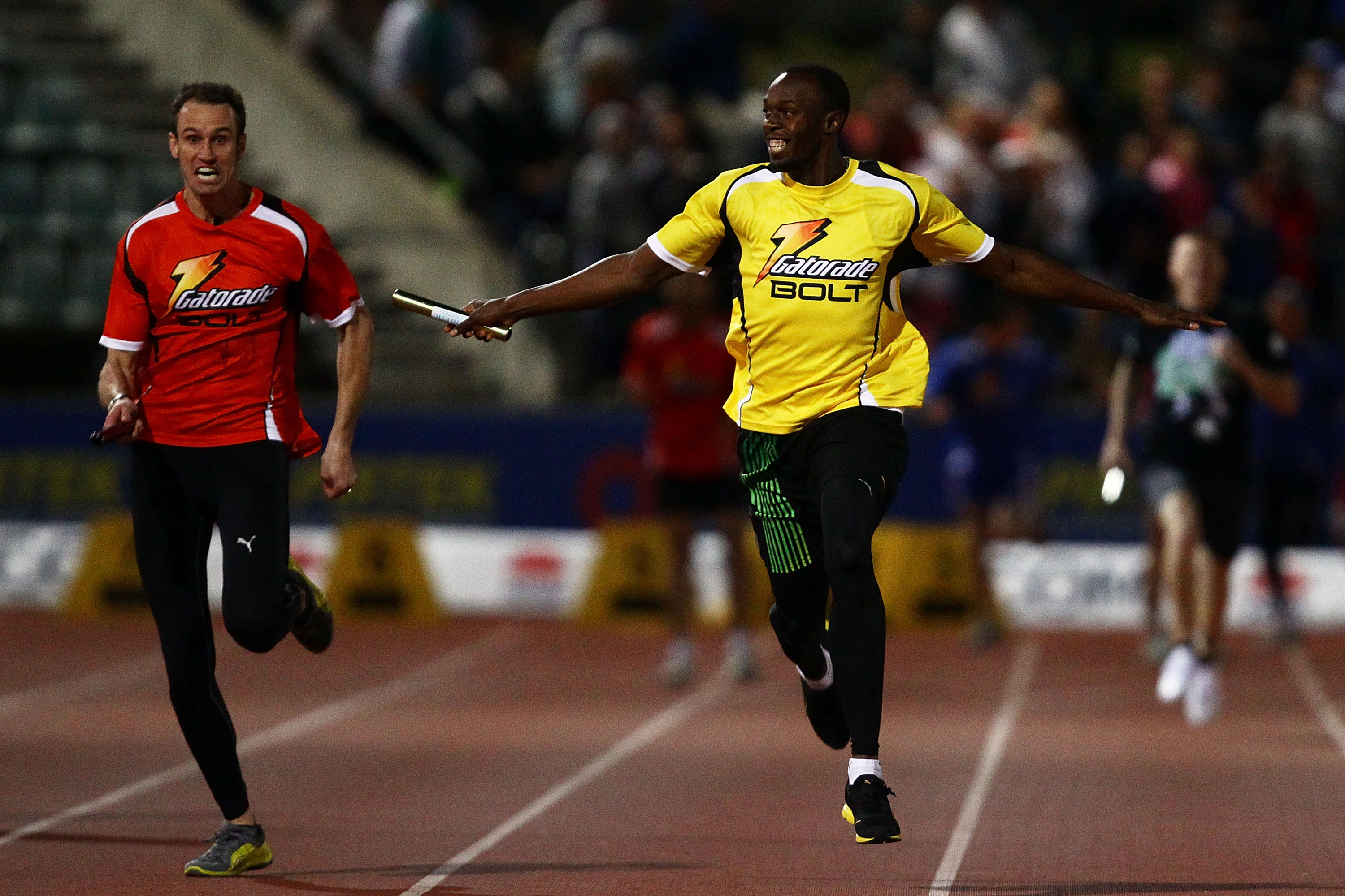 SYDNEY, AUSTRALIA - SEPTEMBER 15:  Usain Bolt (R) of Jamaica and radio personality Ryan Fitzgerald (L) run the final leg of the celebrity relay during the Athletic Allstars Meet at Sydney Olympic Park Athletic Centre on September 15, 2010 in Sydney, Austr