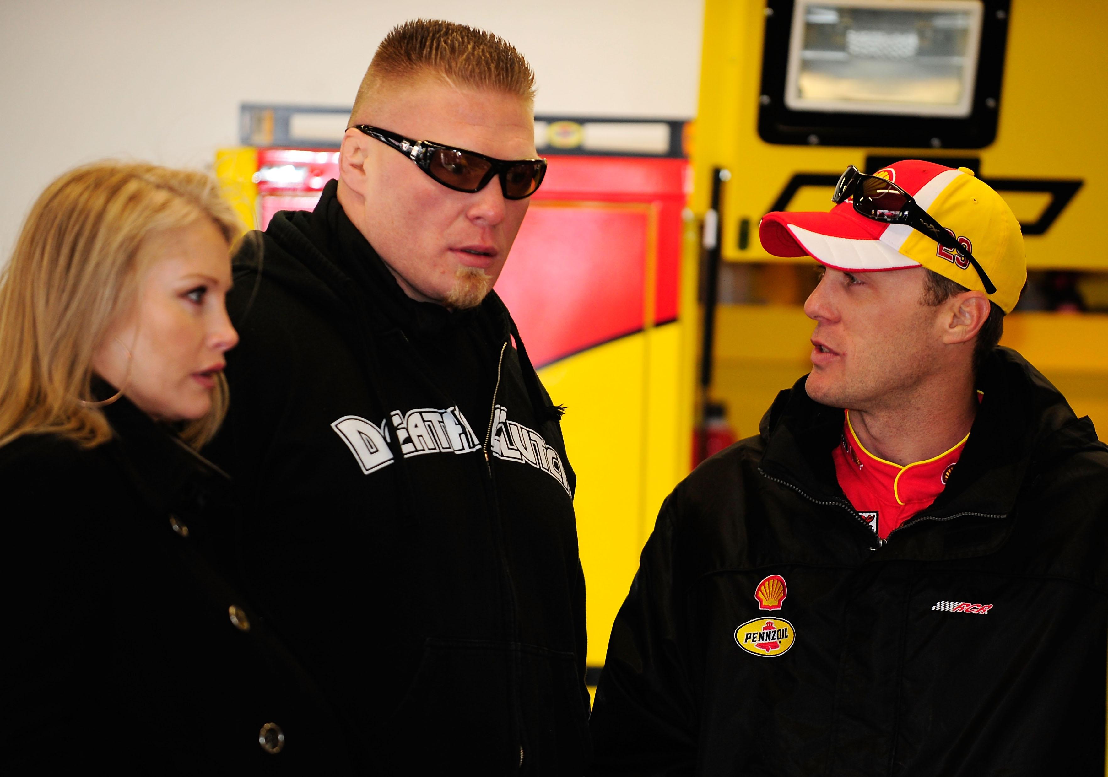 DAYTONA BEACH, FL - FEBRUARY 13:  MMA fighter Brock Lesnar(C)  speaks with Kevin Harvick(R), driver of the #29 Shell/Pennzoil Chevrolet, during practice for the Daytona 500 at Daytona International Speedway on February 13, 2010 in Daytona Beach, Florida.