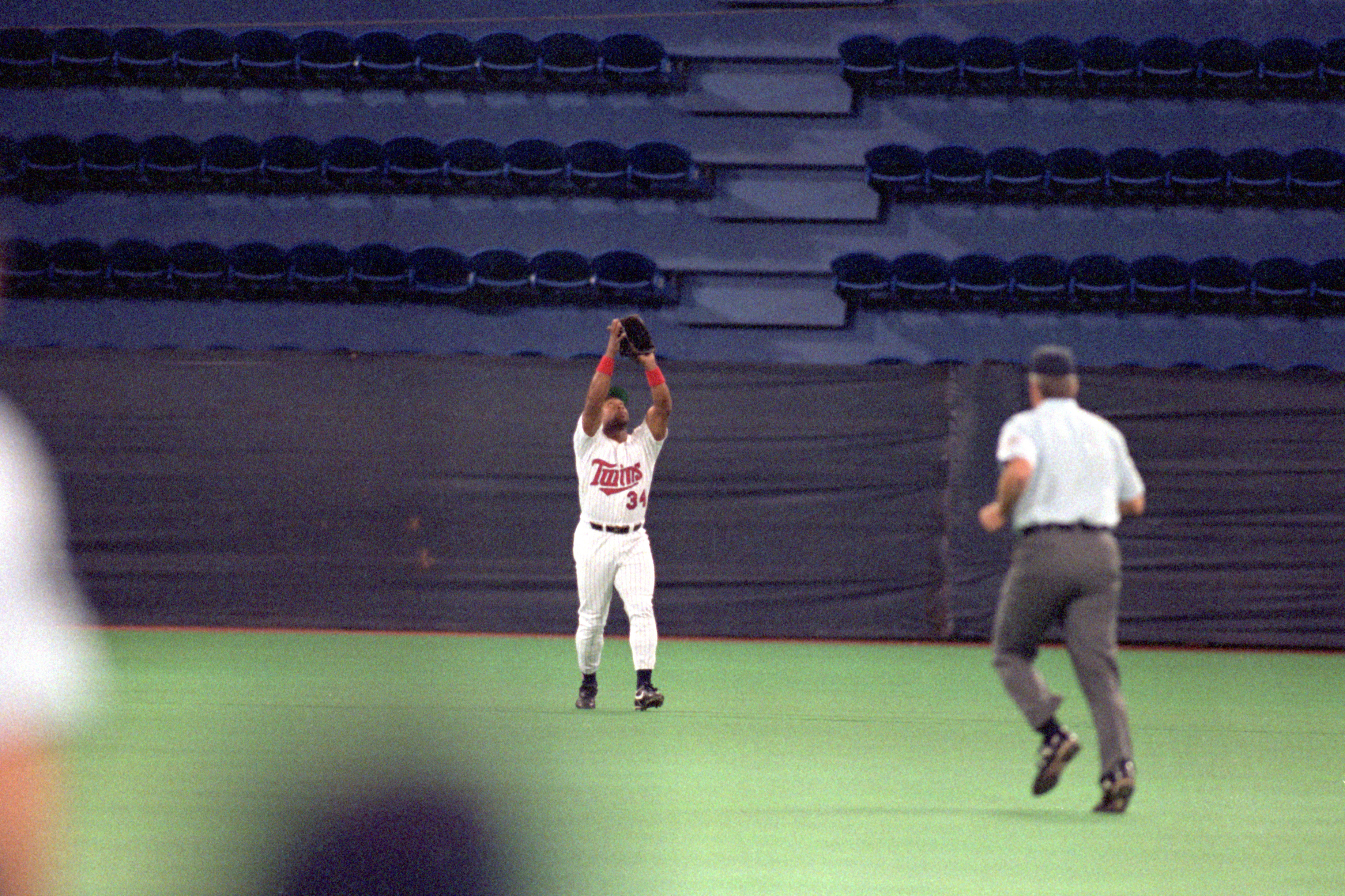 MINNEAPOLIS - OCTOBER 20:  Kirby Puckett #34 of the Minnesota Twins reaches for a pop fly during Game two of the 1991 World Series against the Atlanta Braves at the Metrodome on October 20, 1991 in Minneapolis, Minnesota. The Twins defeated the Braves 3-2