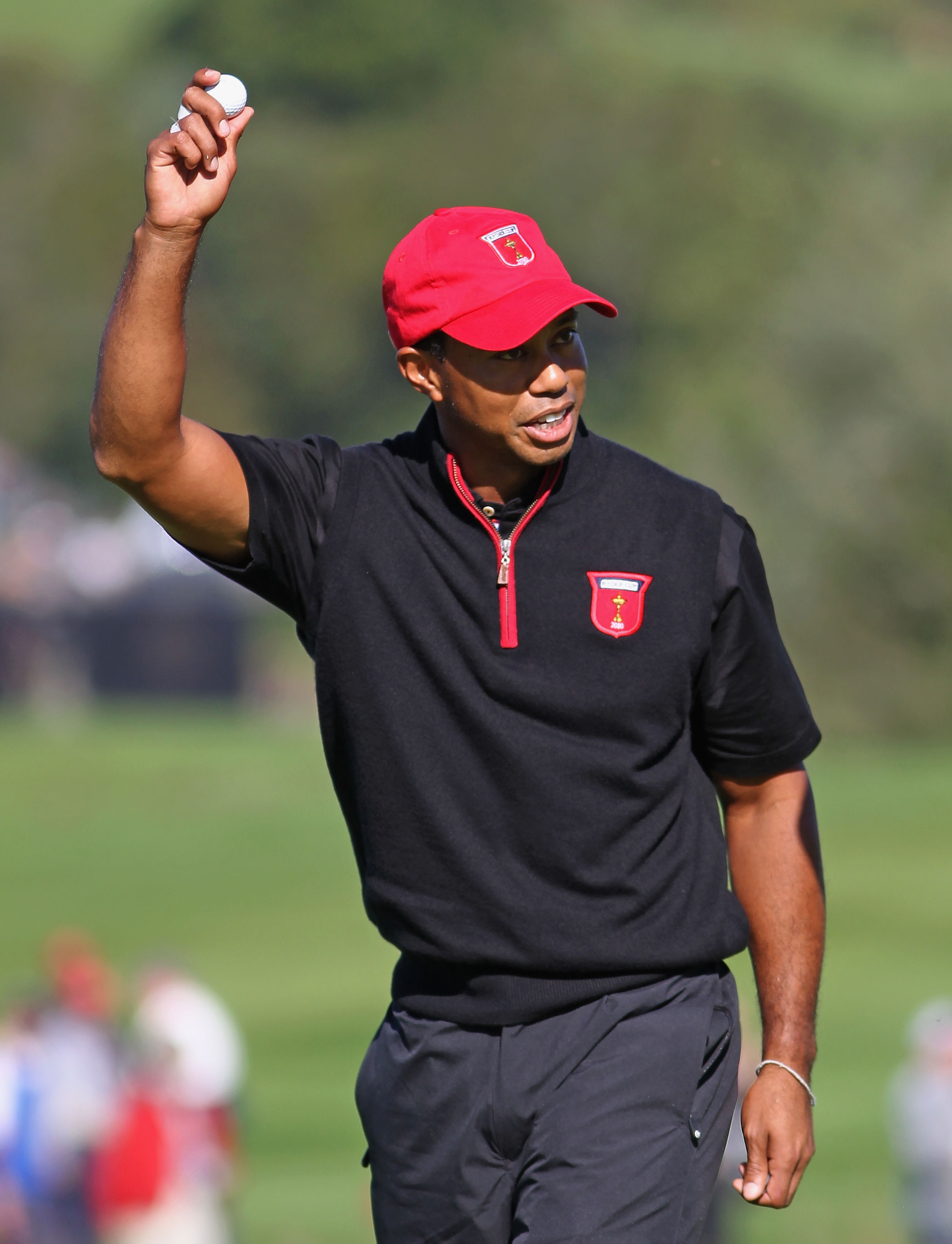 NEWPORT, WALES - OCTOBER 04:  Tiger Woods of the USA acknowledges the crowd after holing out for an eagle on the 12th hole in the singles matches during the 2010 Ryder Cup at the Celtic Manor Resort on October 4, 2010 in Newport, Wales.  (Photo by Jamie S