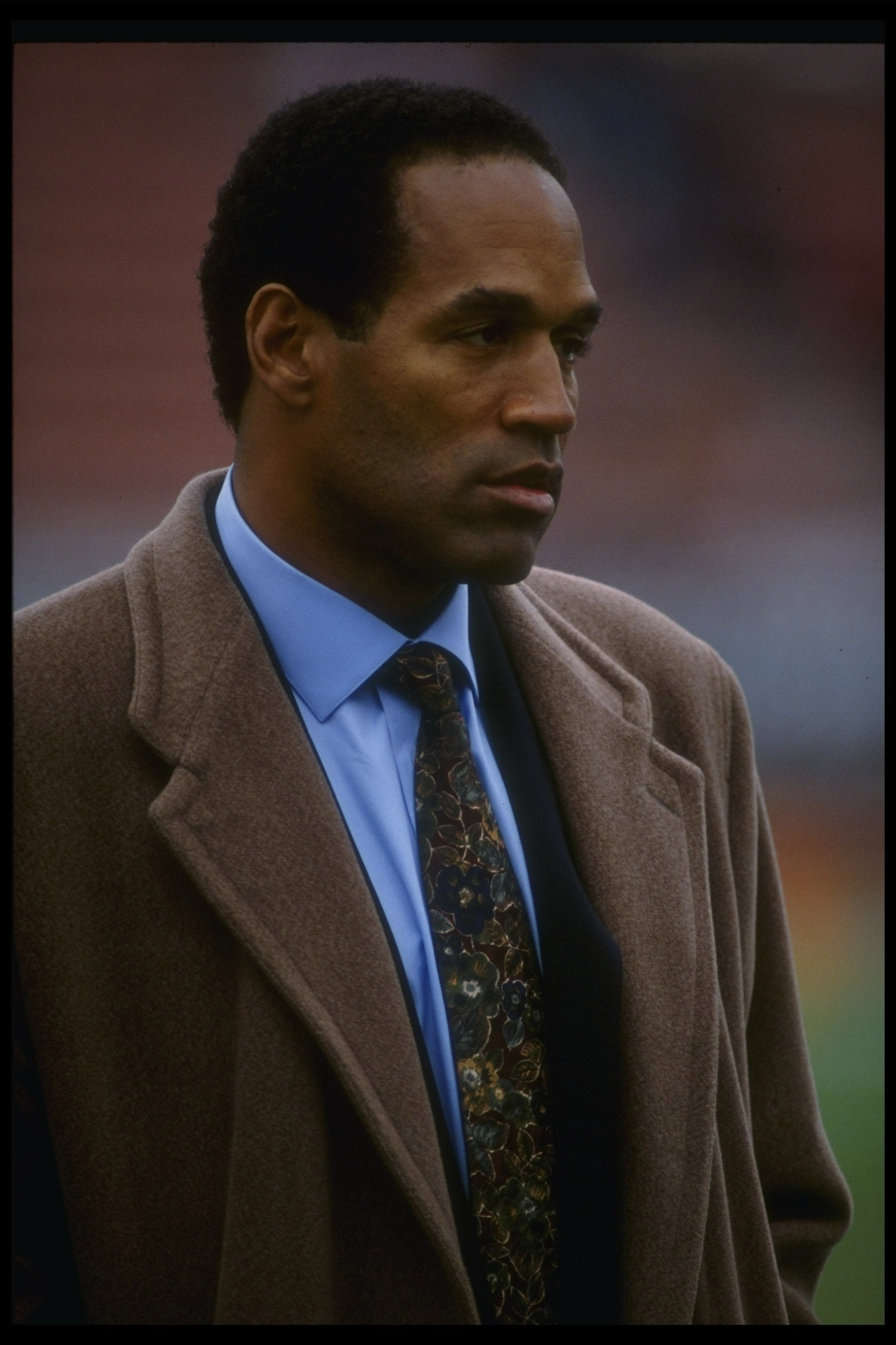 8 Dec 1991:  NBC reporter O.J. Simpson looks on during a game between the Los Angeles Raiders and the Buffalo Bills at the Coliseum in Los Angeles, California.  The Bills won the game, 30-27. Mandatory Credit: Gary Newkirk  /Allsport