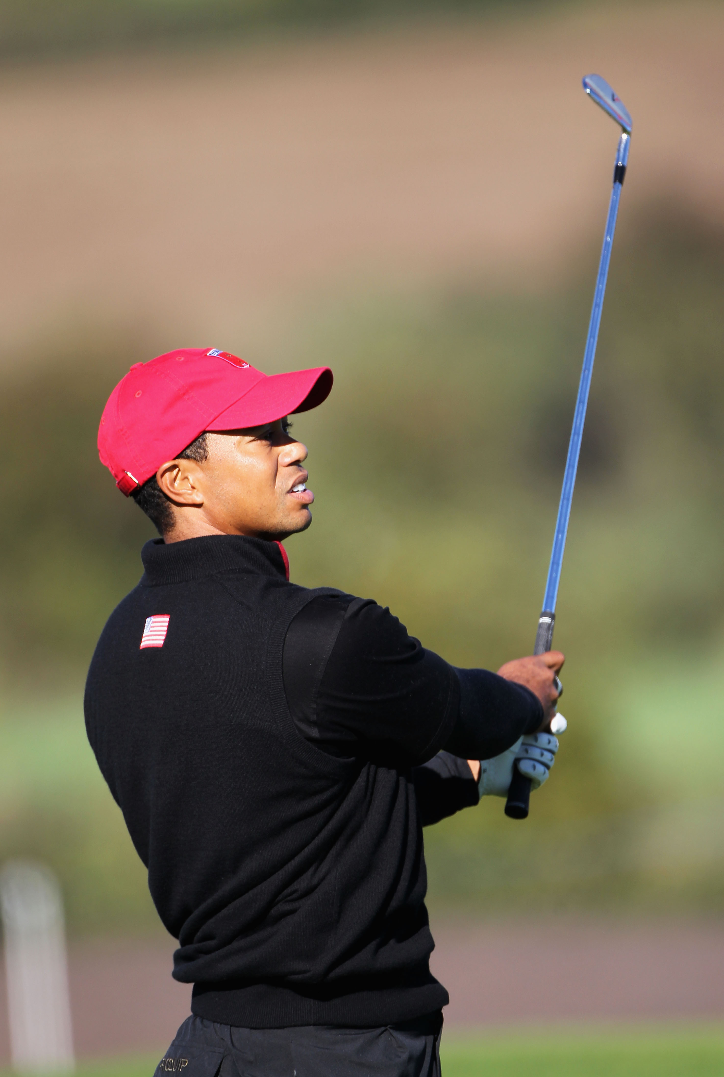 NEWPORT, WALES - OCTOBER 04:  Tiger Woods of the USA hits a shot on the first hole in the singles matches during the 2010 Ryder Cup at the Celtic Manor Resort on October 4, 2010 in Newport, Wales.  (Photo by Jamie Squire/Getty Images)