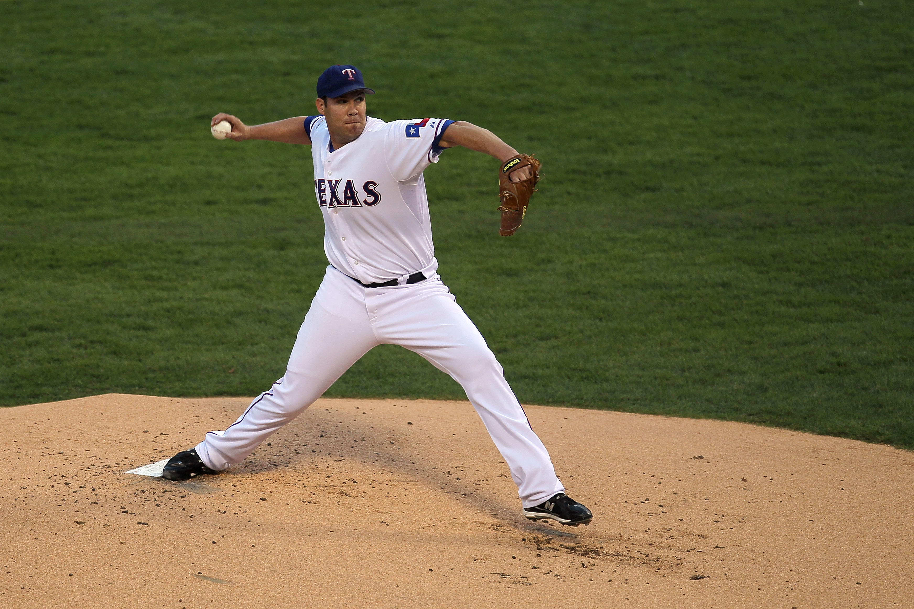 ARLINGTON, TX - OCTOBER 30:  Starting pitcher Colby Lewis #48 of the Texas Rangers pitchs against the San Francisco Giants in Game Three of the 2010 MLB World Series at Rangers Ballpark in Arlington on October 30, 2010 in Arlington, Texas.  (Photo by Step