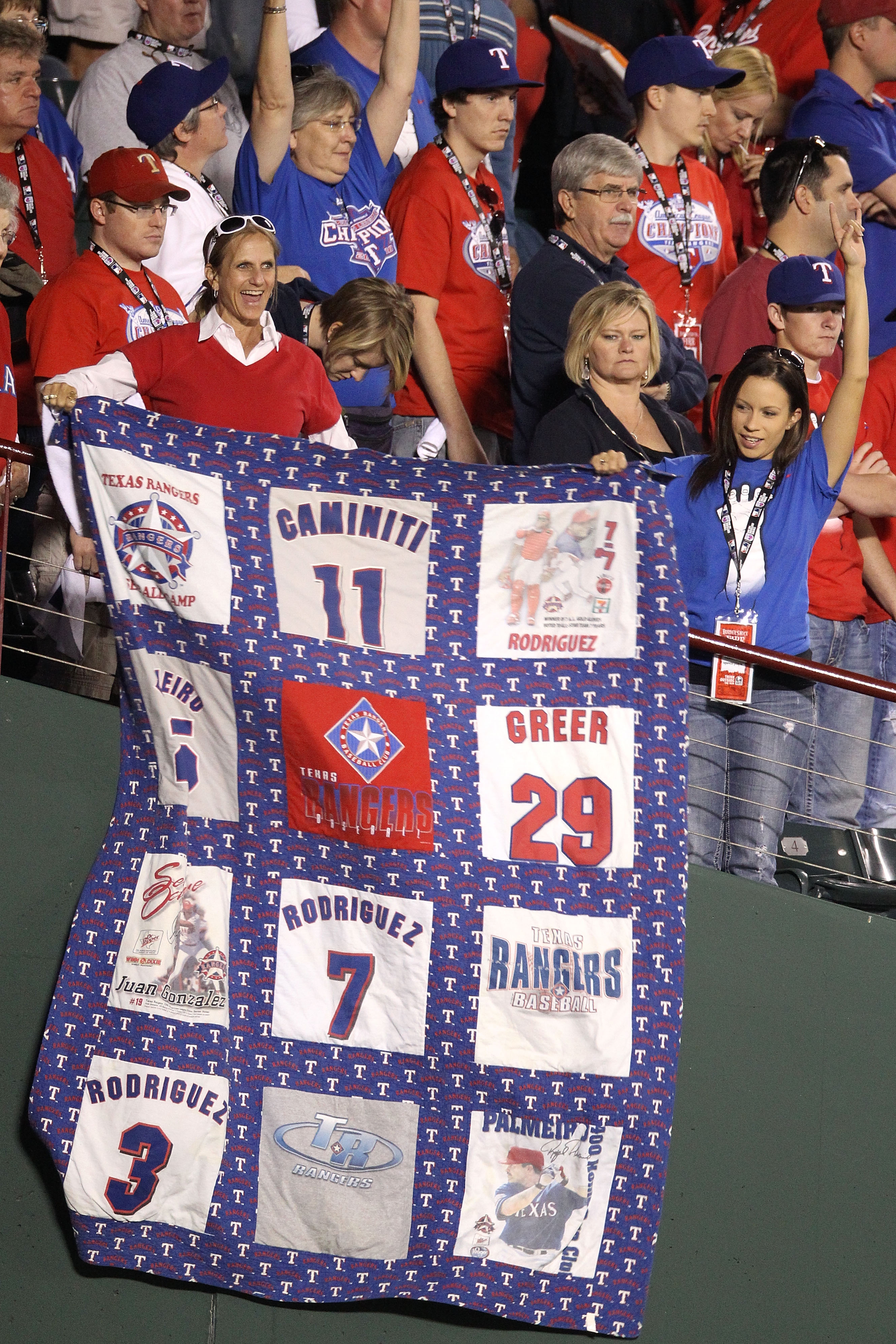 ARLINGTON, TX - OCTOBER 30:  Fans of the Texas Rangers celebrate with a Rangers quilt as the Rangers defeat the San Francisco Giants 4-2 in Game Three of the 2010 MLB World Series at Rangers Ballpark in Arlington on October 30, 2010 in Arlington, Texas.
