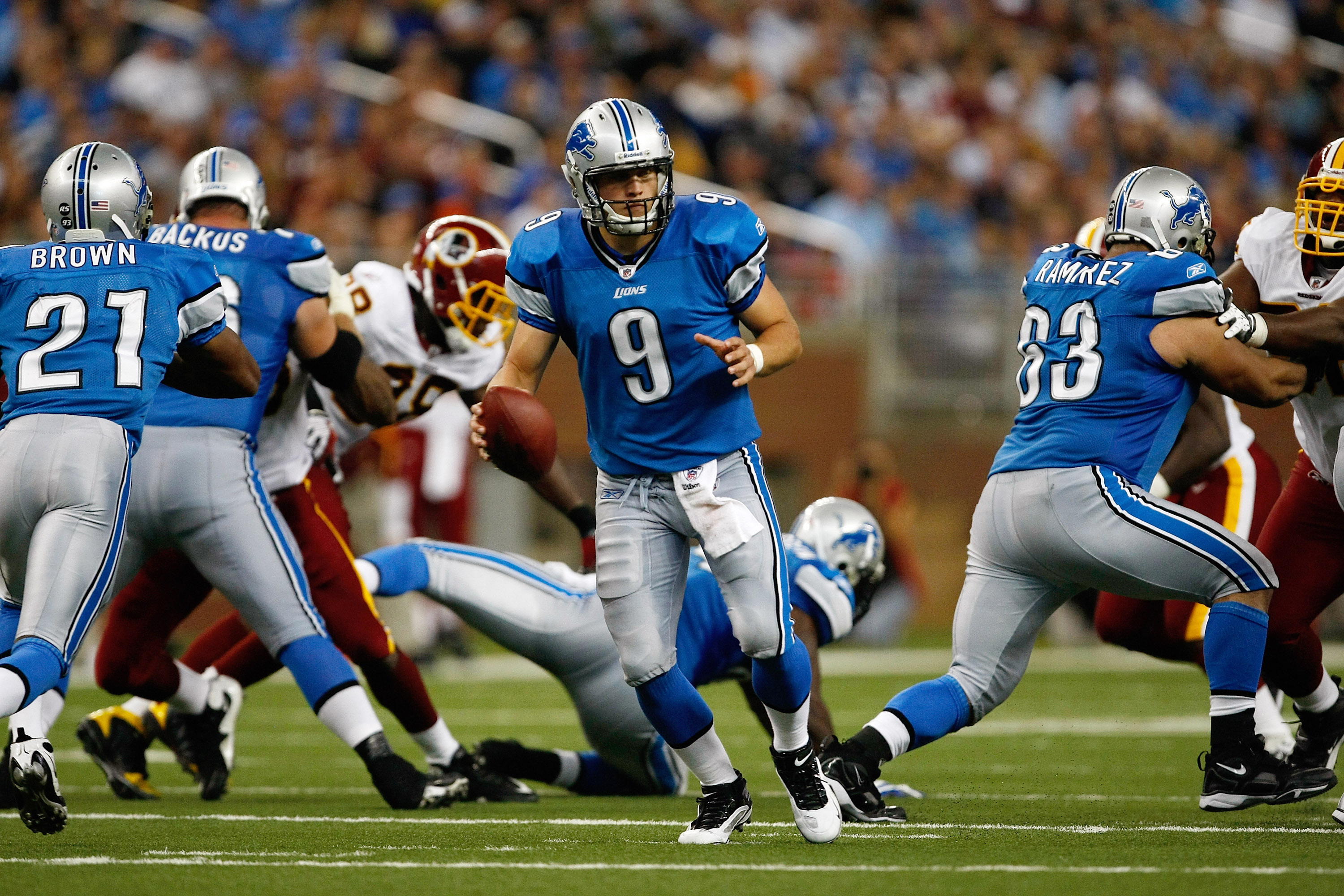 DETROIT, MI - SEPTEMBER 27: Quarterback Matthew Stafford #9 of the Detroit Lions runs with the football against the Washington Redskins at Ford Field on September 27, 2009 in Detroit, Michigan. The Lions defeated the Redskins 19-14. (Photo by Scott Boehm/
