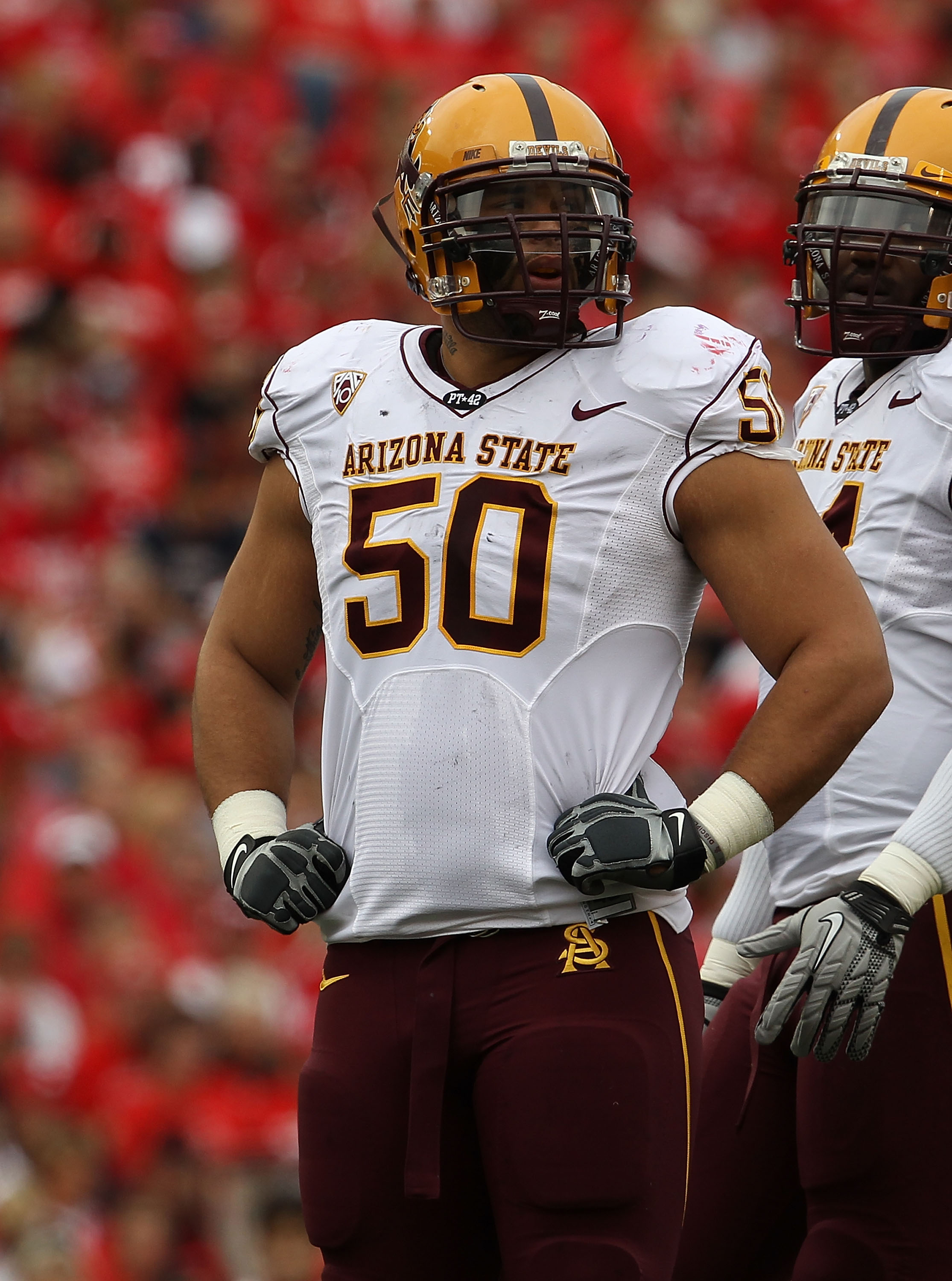 MADISON, WI - SEPTEMBER 18: Lawerence Guy #50 of the Arizona State Sun Devils waits during a time-out against the Wisconsin Badgers at Camp Randall Stadium on September 18, 2010 in Madison, Wisconsin. Wisconsin defeated Arizona State 20-19.  (Photo by Jon