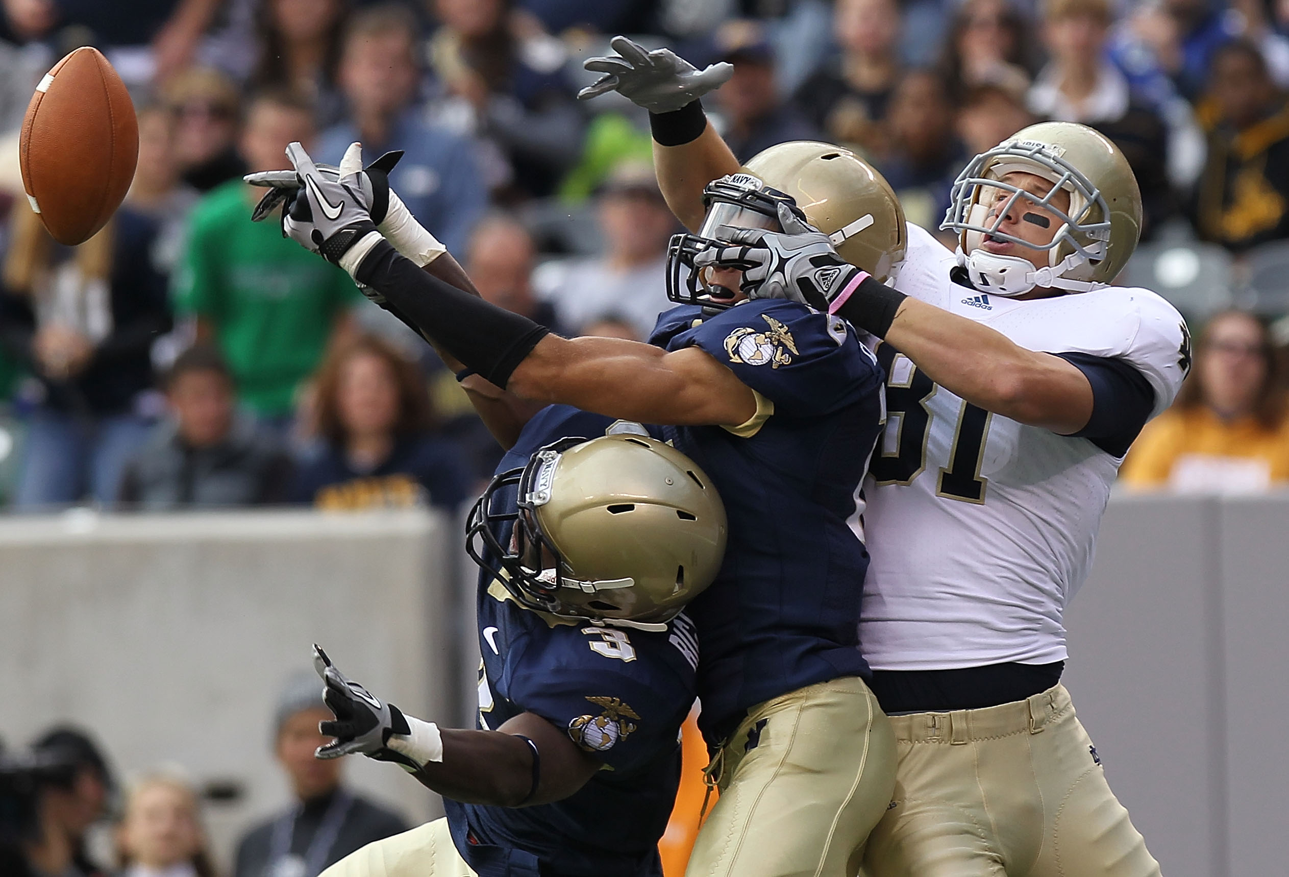 EAST RUTHERFORD, NJ - OCTOBER 23: (L-R) De'Von Richardson #3 and Kevin Edwards #15 of the Navy Midshipmen break up the pass against John Goodman #81 of the Notre Dame Fighting Irish at New Meadowlands Stadium on October 23, 2010 in East Rutherford, New Je