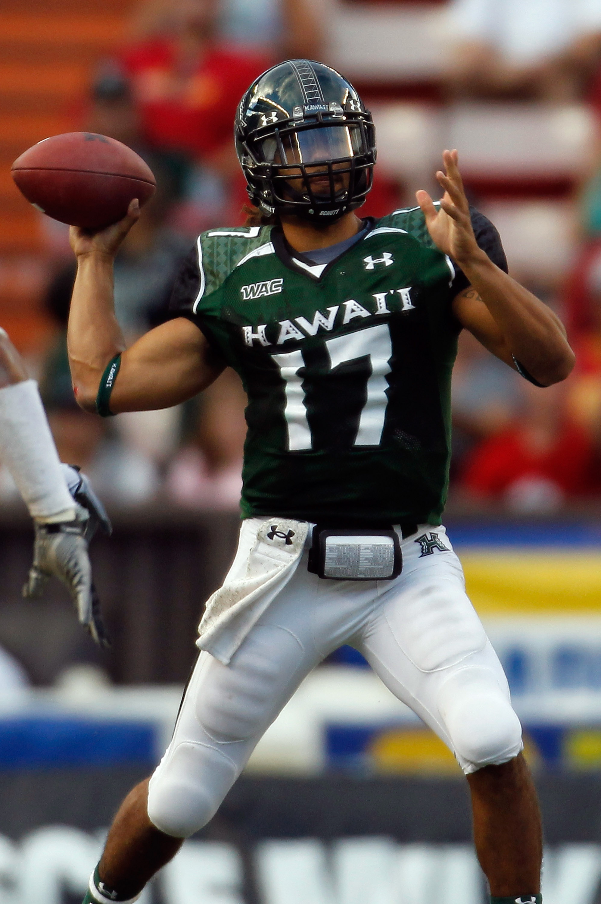 HONOLULU - SEPTEMBER 2:  Quarterback Bryant Moniz #17 of the University of Hawaii Warriors makes a pass against the University of Southern California Trojans during first half action at Aloha Stadium September 2, 2010 in Honolulu, Hawaii. (Photo by Kent N