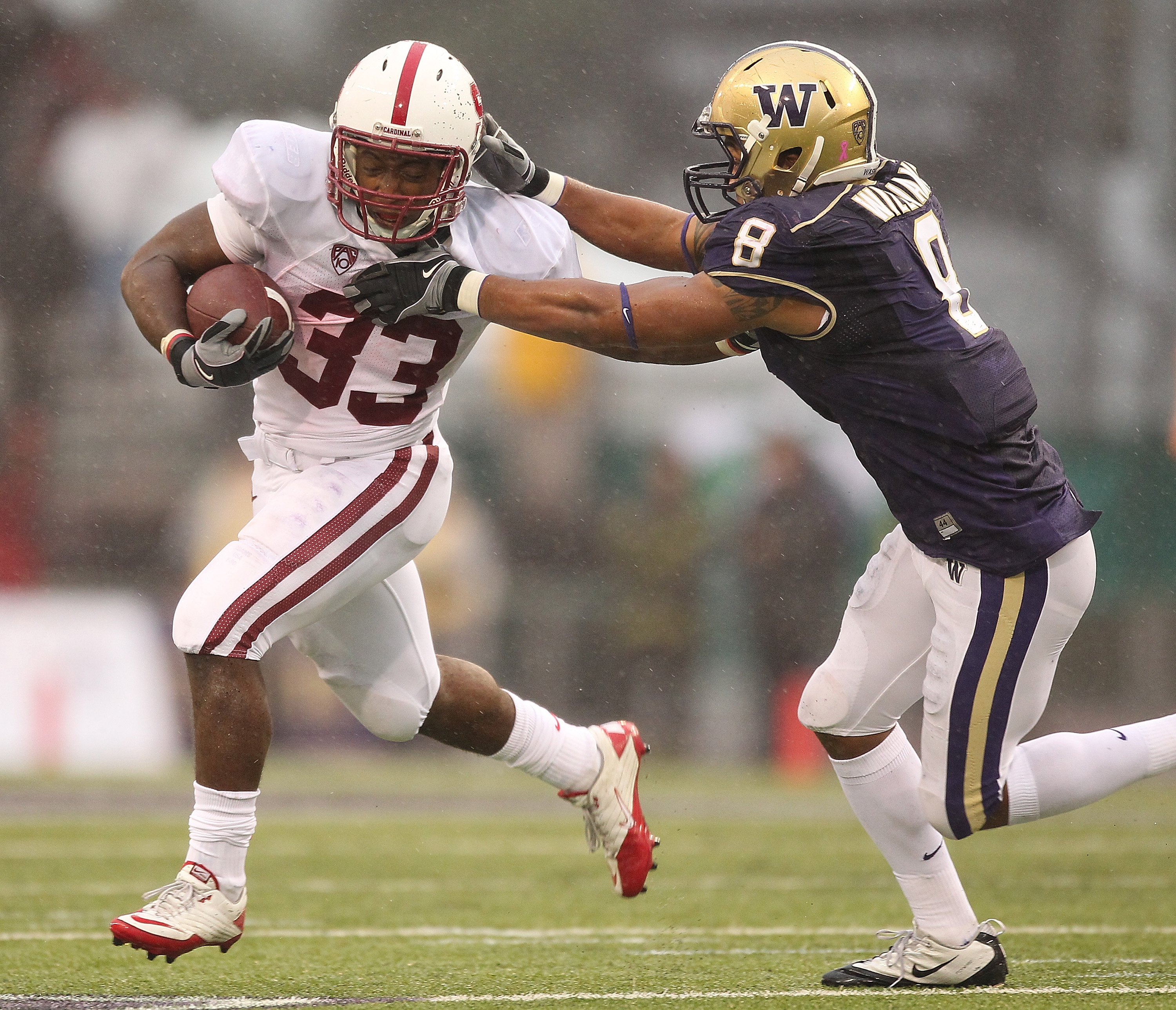 SEATTLE - OCTOBER 30:  Running back Stepfan Taylor #33 of the Stanford Cardinal rushes against Nate Williams #8 of the Washington Huskies on October 30, 2010 at Husky Stadium in Seattle, Washington. Stanford defeated Washington 41-0. (Photo by Otto Greule