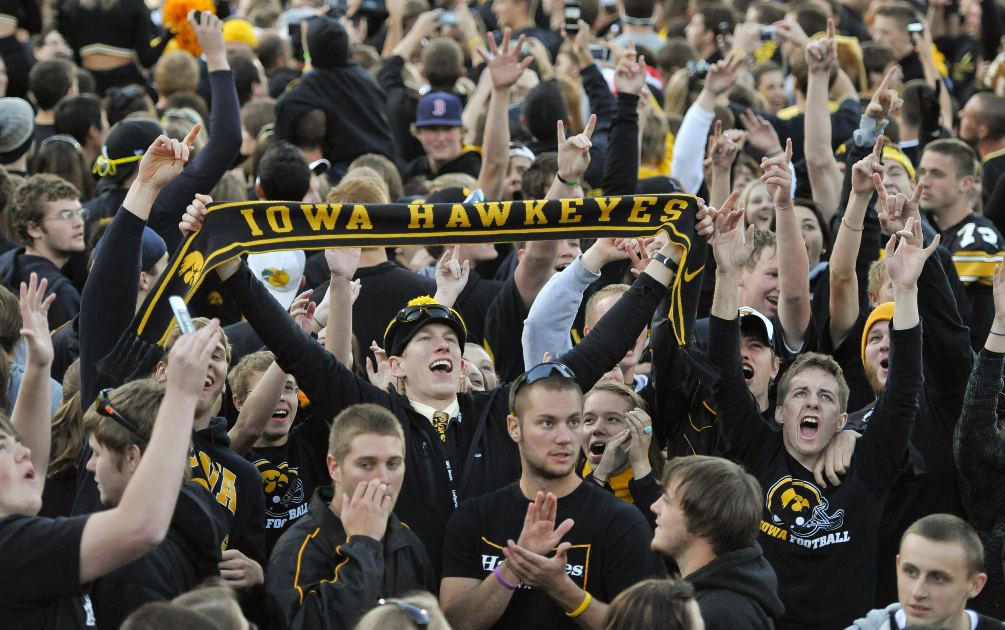 IOWA CITY, IA - OCTOBER 30: University of Iowa Hawkeyes fans celebrate their win over the Michigan State Spartans at Kinnick Stadium on October 30, 2010 in Iowa City, Iowa. Iowa won 37-6 over Michigan State. (Photo by David Purdy/Getty Images)