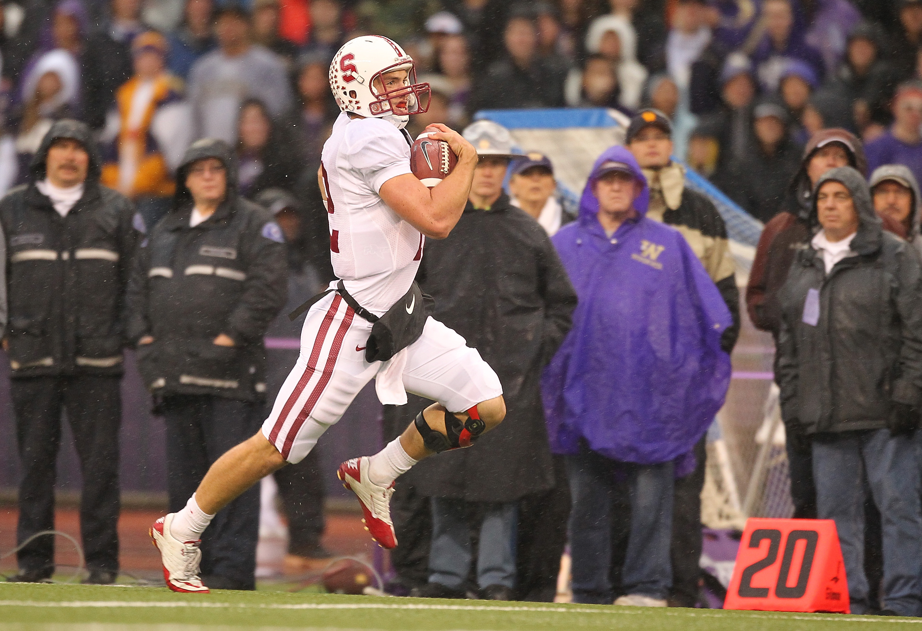 SEATTLE - OCTOBER 30:  Quarterback Andrew Luck #12 of the Stanford Cardinal rushes for a 51 yard touchdown in the first quarter against the Washington Huskies on October 30, 2010 at Husky Stadium in Seattle, Washington. Stanford defeated Washington 41-0.(