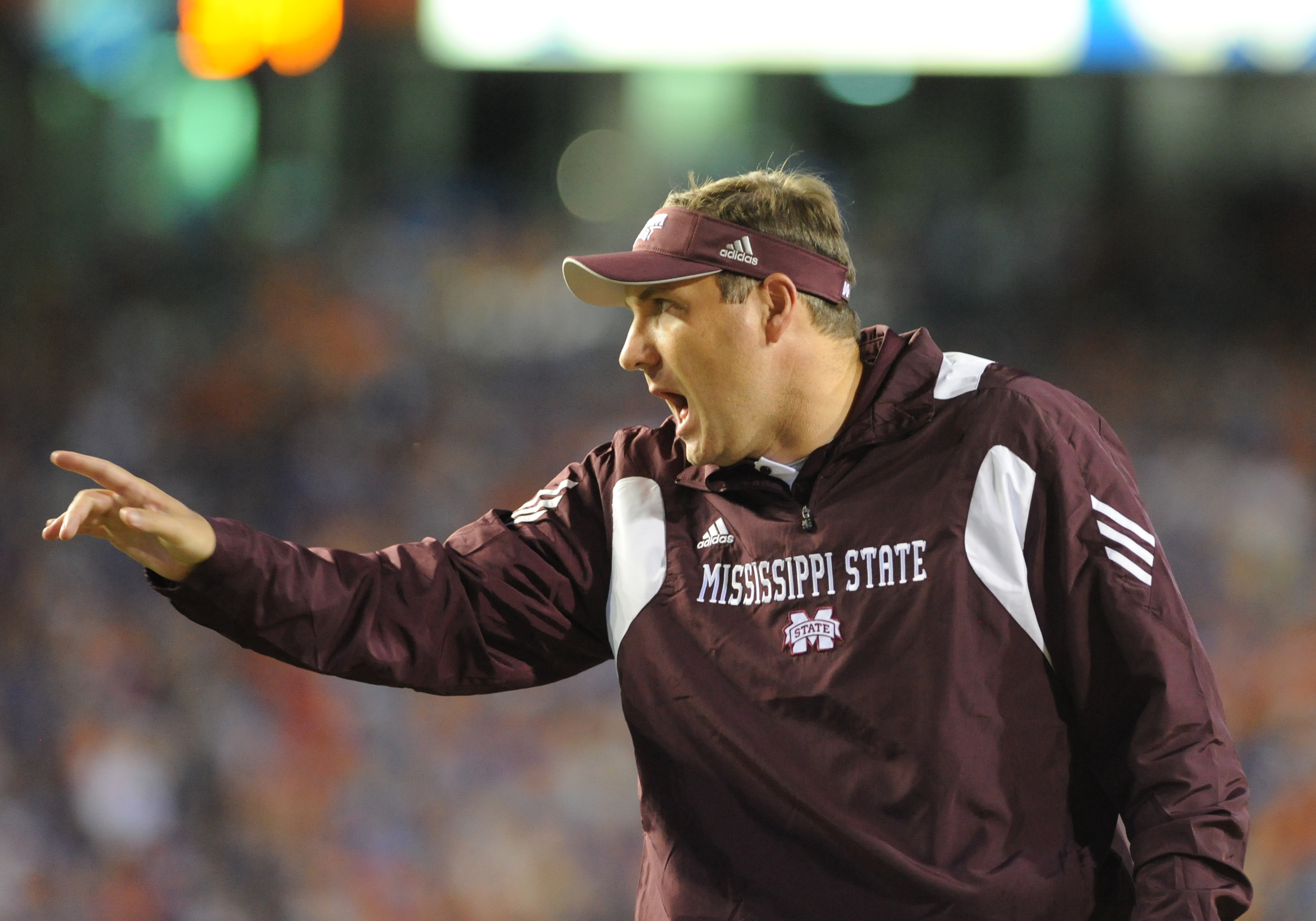 GAINESVILLE, FL - OCTOBER 16:  Coach Dan Mullen of the Mississippi State Bulldogs directs play against the Florida Gators  October 16, 2010 Ben Hill Griffin Stadium at Gainesville, Florida.  (Photo by Al Messerschmidt/Getty Images)