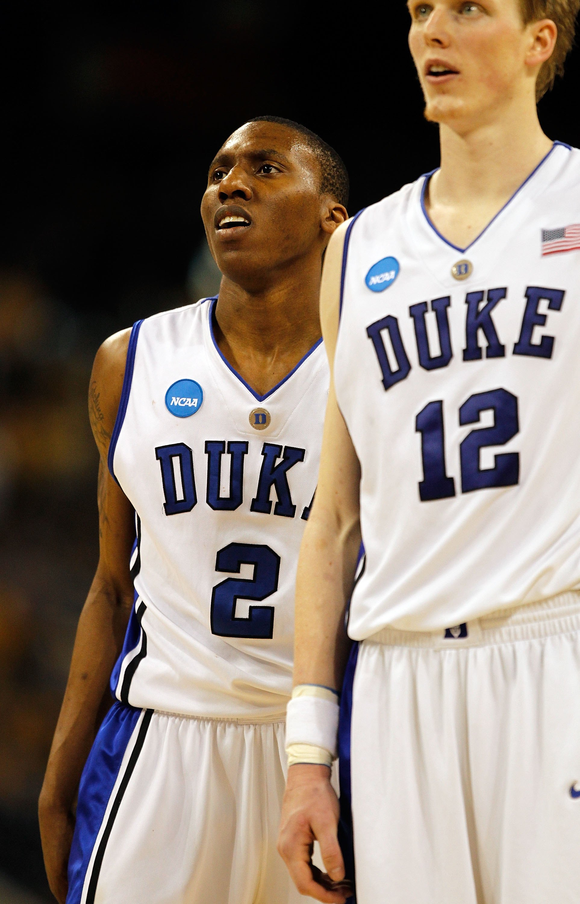 HOUSTON - MARCH 28: Nolan Smith #2 and Kyle Singler #12 of the Duke Blue Devils wait as a teammate shoots free-throws against the Baylor Bears during the south regional final of the 2010 NCAA men's basketball tournament at Reliant Stadium on March 28, 201