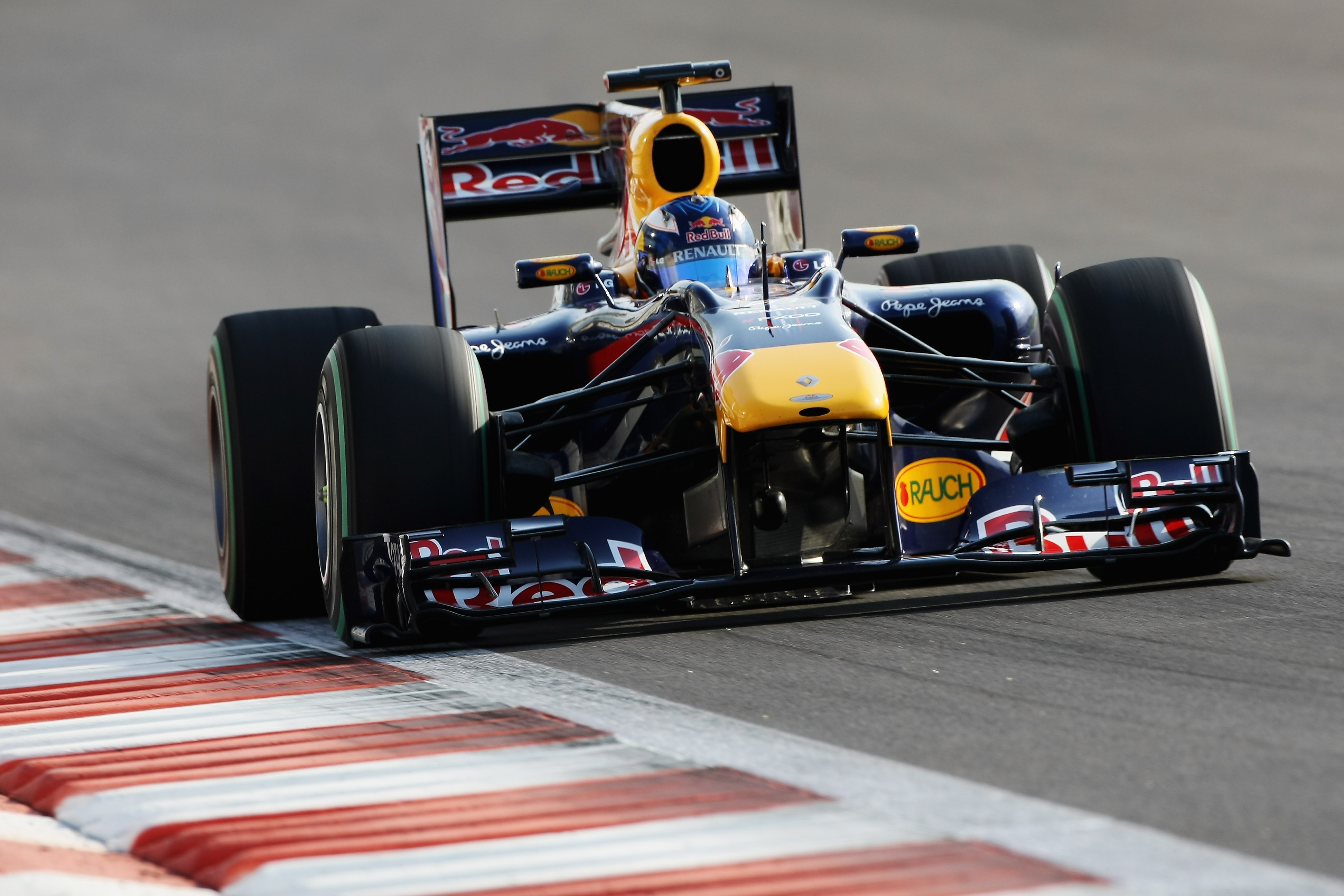 ABU DHABI, UNITED ARAB EMIRATES - NOVEMBER 16: Daniel Ricciardo of Australia and Red Bull Racing in action during the Young Driver Testing at the Yas Marina Circuit on November 16, 2010 in Abu Dhabi, United Arab Emirates. (Photo by Andrew Hone/Getty Image