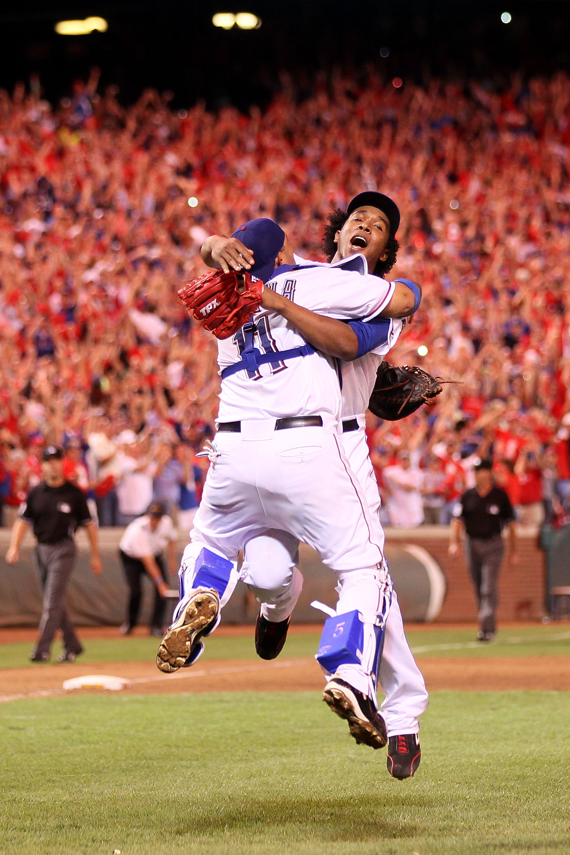 ARLINGTON, TX - OCTOBER 22:  Bengie Molina #11 and Neftali Feliz #30 of the Texas Rangers celebrate after defeating the New York Yankees 6-1 in Game Six of the ALCS to advance to the World Series during the 2010 MLB Playoffs at Rangers Ballpark in Arlingt