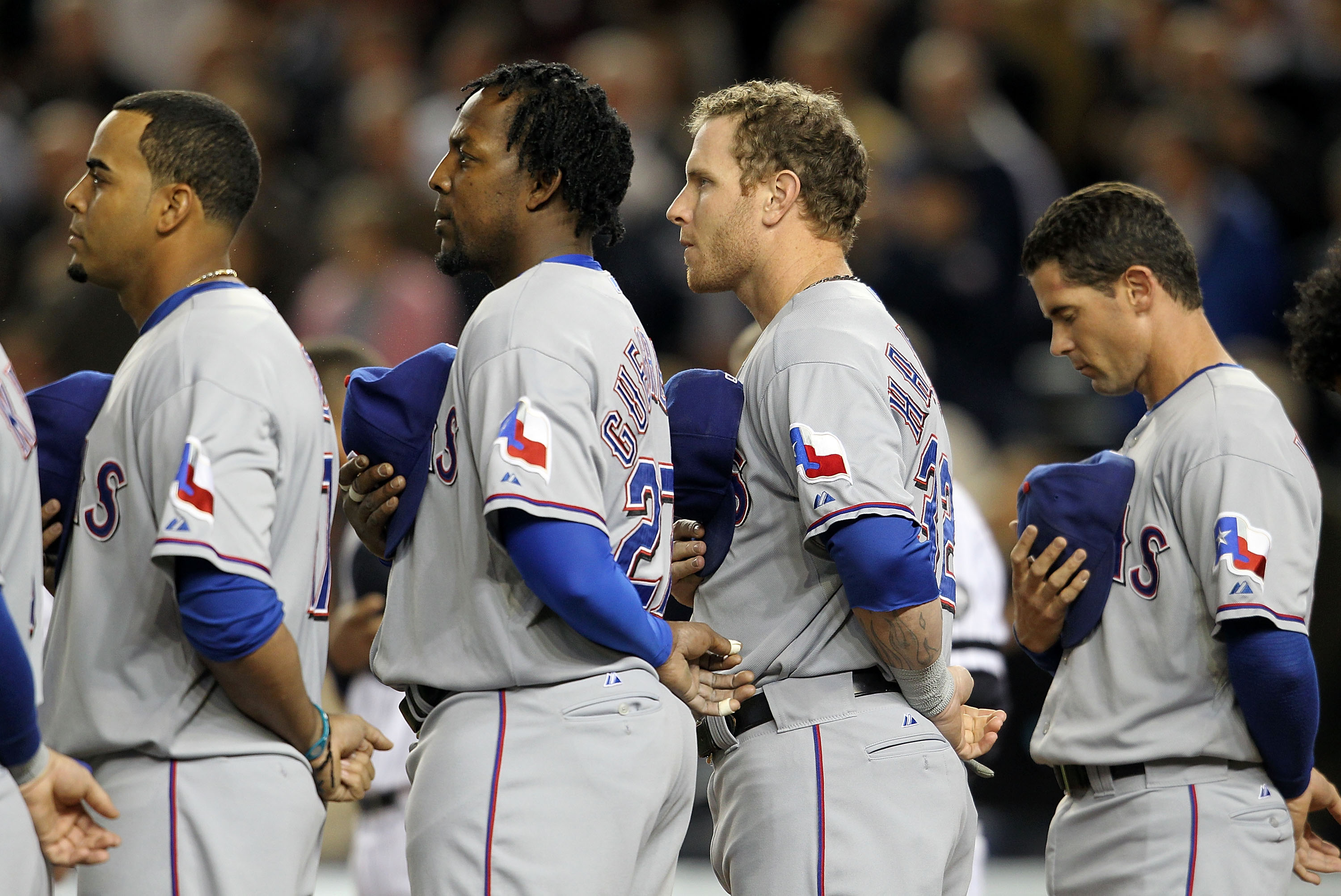 NEW YORK - OCTOBER 18:  Nelson Cruz #17, Vladimir Guerrero #27, Josh Hamilton #32 and Michael Young #10 of the Texas Rangers stand for pregame festivities against the New York Yankees in Game Three of the ALCS during the 2010 MLB Playoffs at Yankee Stadiu
