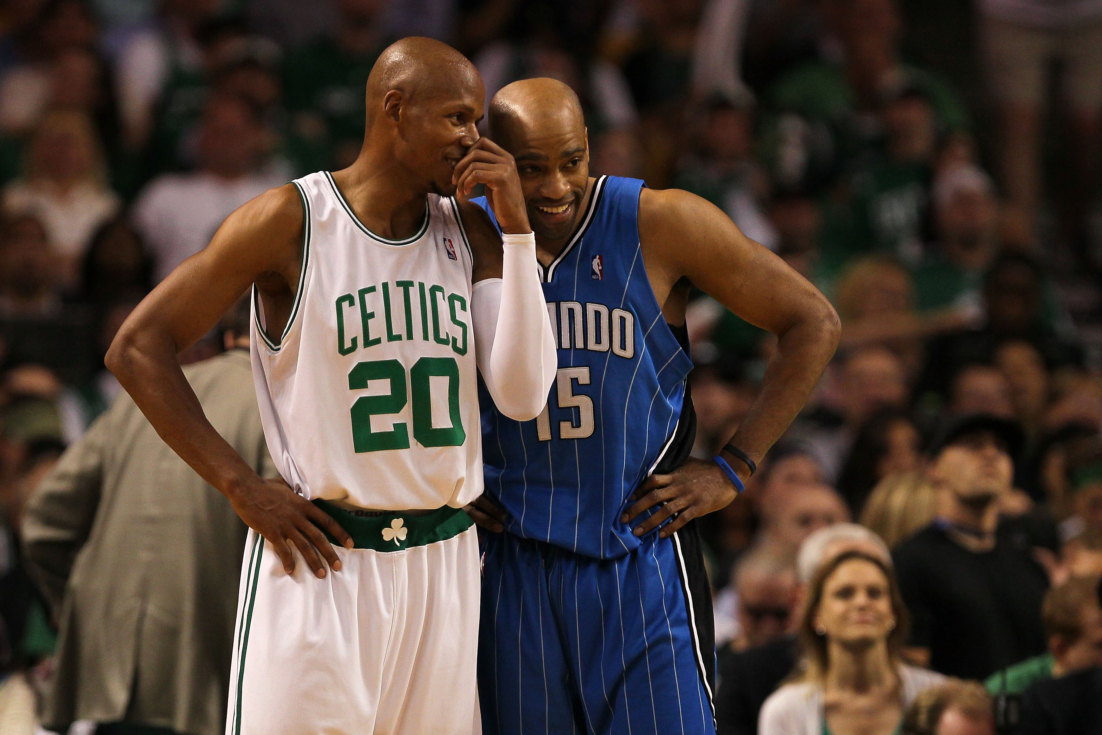 BOSTON - MAY 24:  Ray Allen #20 of the Boston Celtics talks with Vince Carter #15 of the Orlando Magic in Game Four of the Eastern Conference Finals during the 2010 NBA Playoffs at TD Banknorth Garden on May 24, 2010 in Boston, Massachusetts.  NOTE TO USE