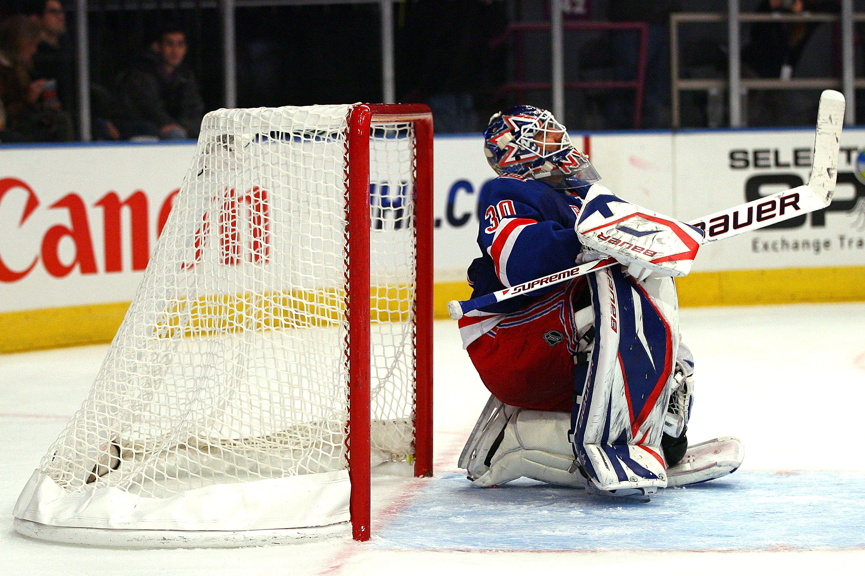 NEW YORK - OCTOBER 29:  Henrik Lundqvist #30 of the New York Rangers sits on the ice after allowing Erik Cole, of the Carolina Hurricanes, to score the game winning goal in the third period on October 29, 2010 at Madison Square Garden in New York City, Ne