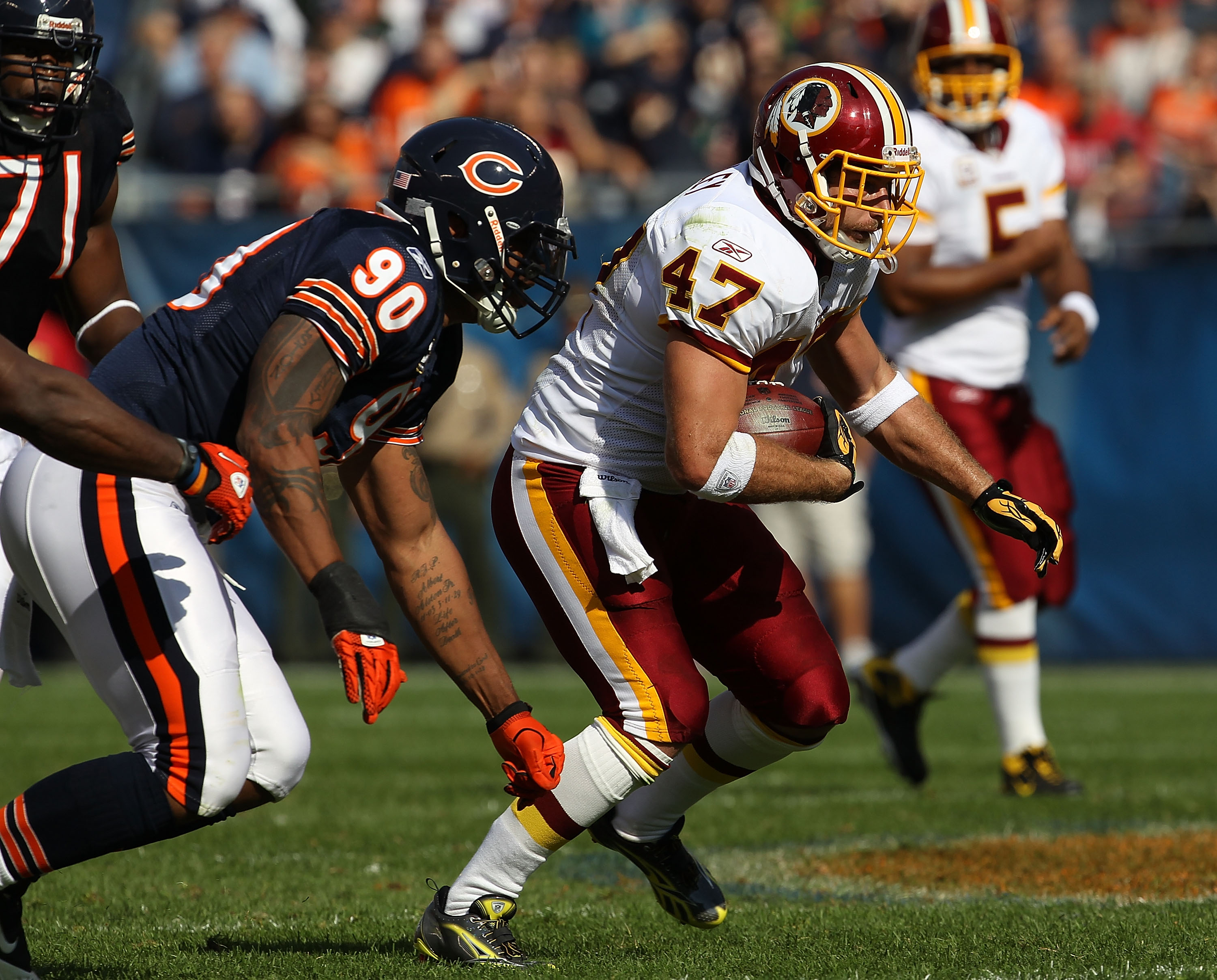 CHICAGO - OCTOBER 24: Chris Cooley #47 of the Washington Redskins runs pursued by Julius Peppers #90 of the Chicago Bears at Soldier Field on October 24, 2010 in Chicago, Illinois. The Redskins defeated the Bears 17-14. (Photo by Jonathan Daniel/Getty Ima