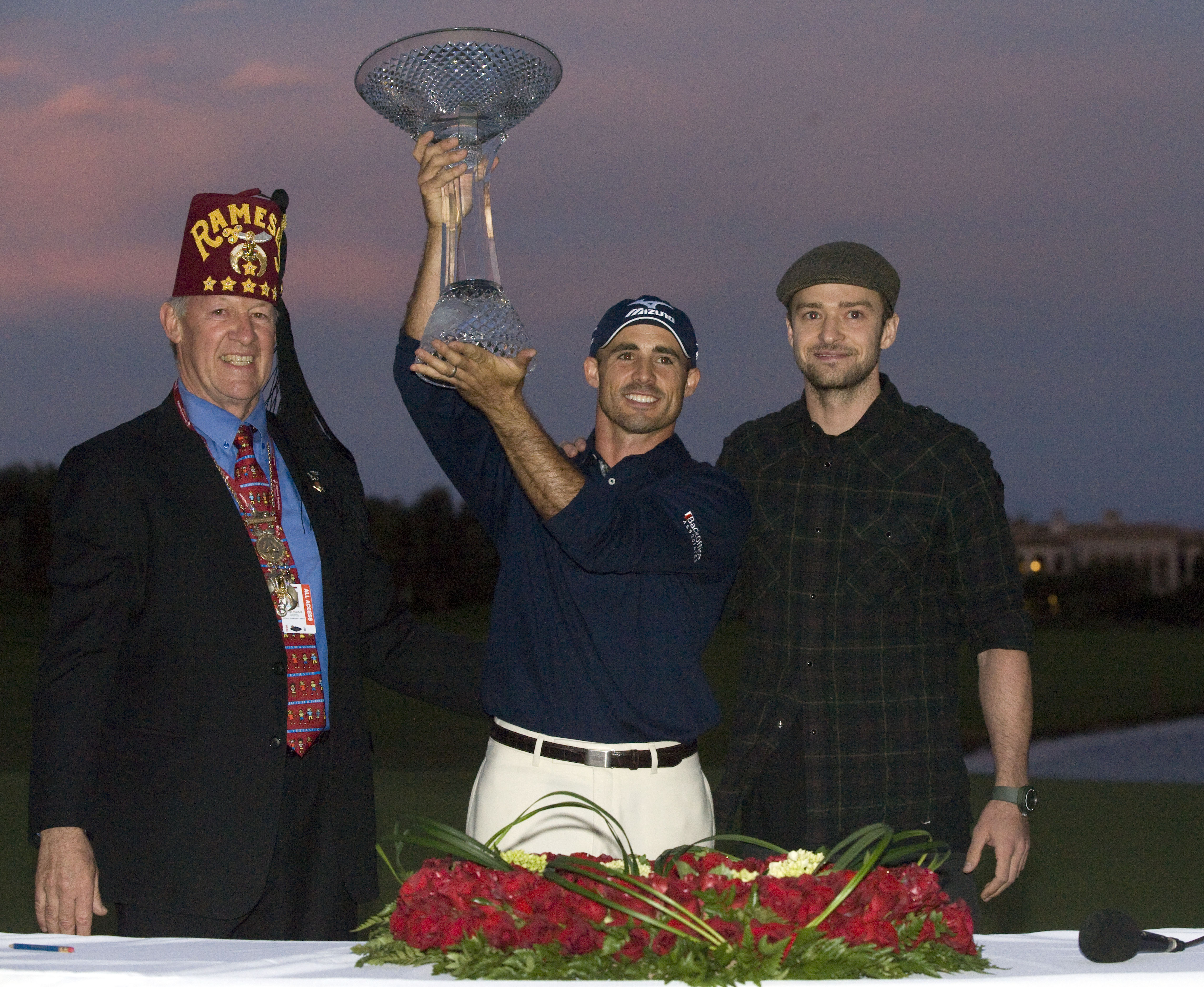 LAS VEGAS, NV - OCTOBER 24: (L - R) Shriner George Mitchell, golfer Jonathan Byrd and Justin Timberlake pose with the trophy after Byrd hit a hole-in-one to win the tournament at the Justin Timberlake Shriners Hospitals for Children Open at TPC Sunderlin