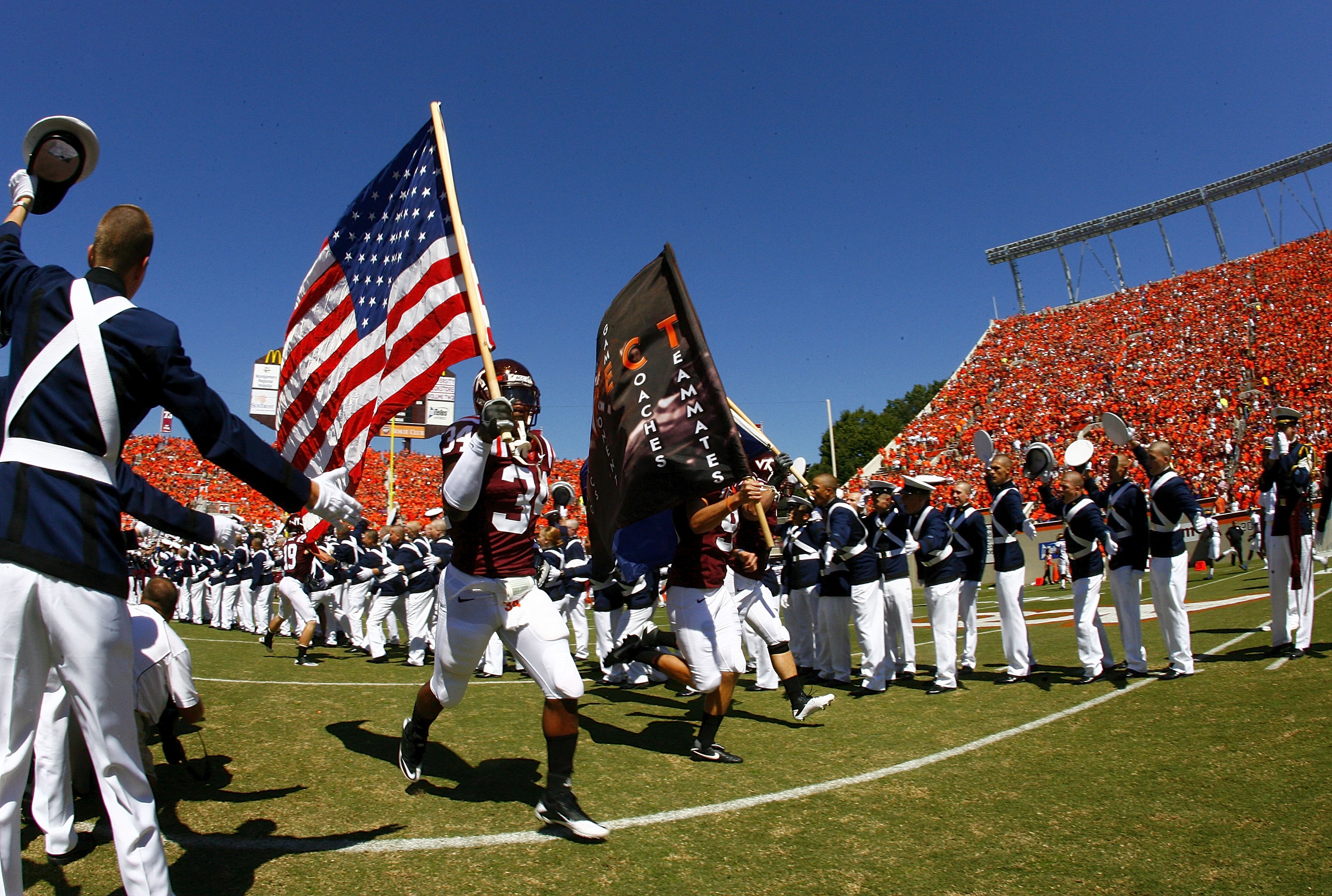 BLACKSBURG, VA - SEPTEMBER 18: Virginia Tech Hokies players take the field prior to the Hokies game against the East Carolina Pirates at Lane Stadium on September 18, 2010 in Blacksburg, Virginia.  (Photo by Geoff Burke/Getty Images)