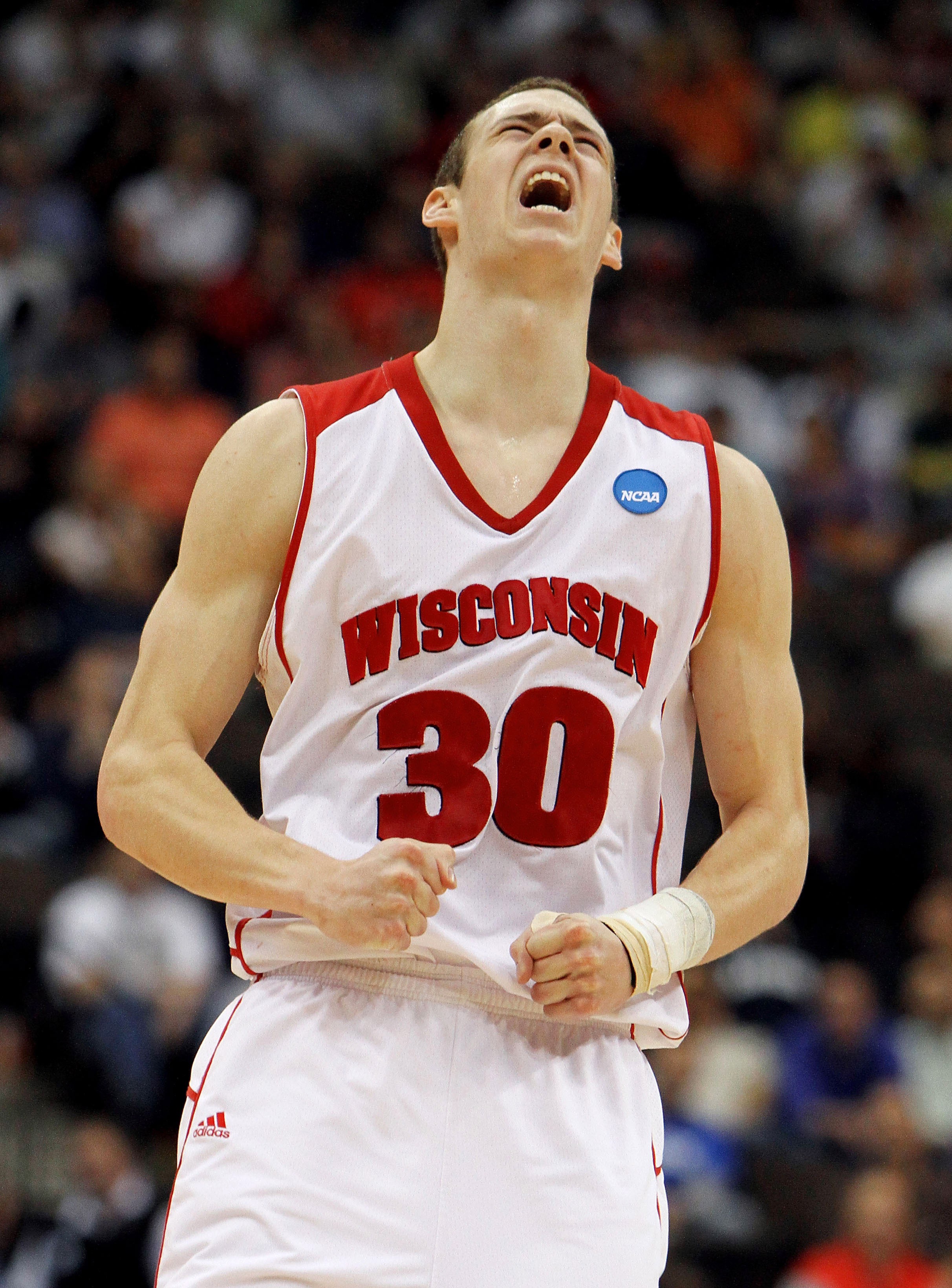 JACKSONVILLE, FL - MARCH 19:  Jon Leuer #30 of the Wisconsin Badgers celebrates after hitting a shot in the second half against the Wofford Terriers during the first round of the 2010 NCAA men's basketball tournament at Jacksonville Veteran's Memorial Are