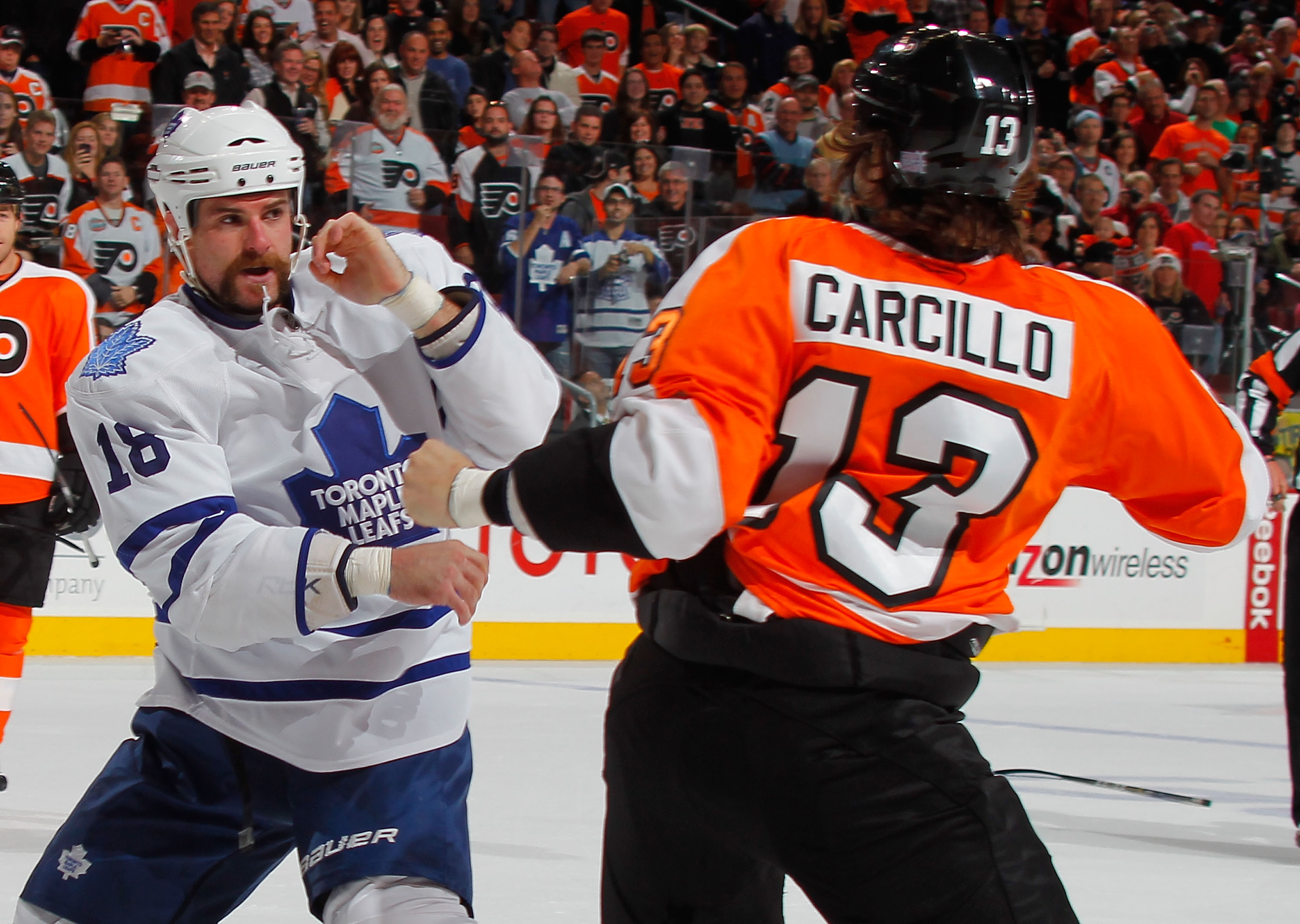 PHILADELPHIA - OCTOBER 23  Mike Brown  18 of the Toronto Maple Leafs fights  with e847cc2a5