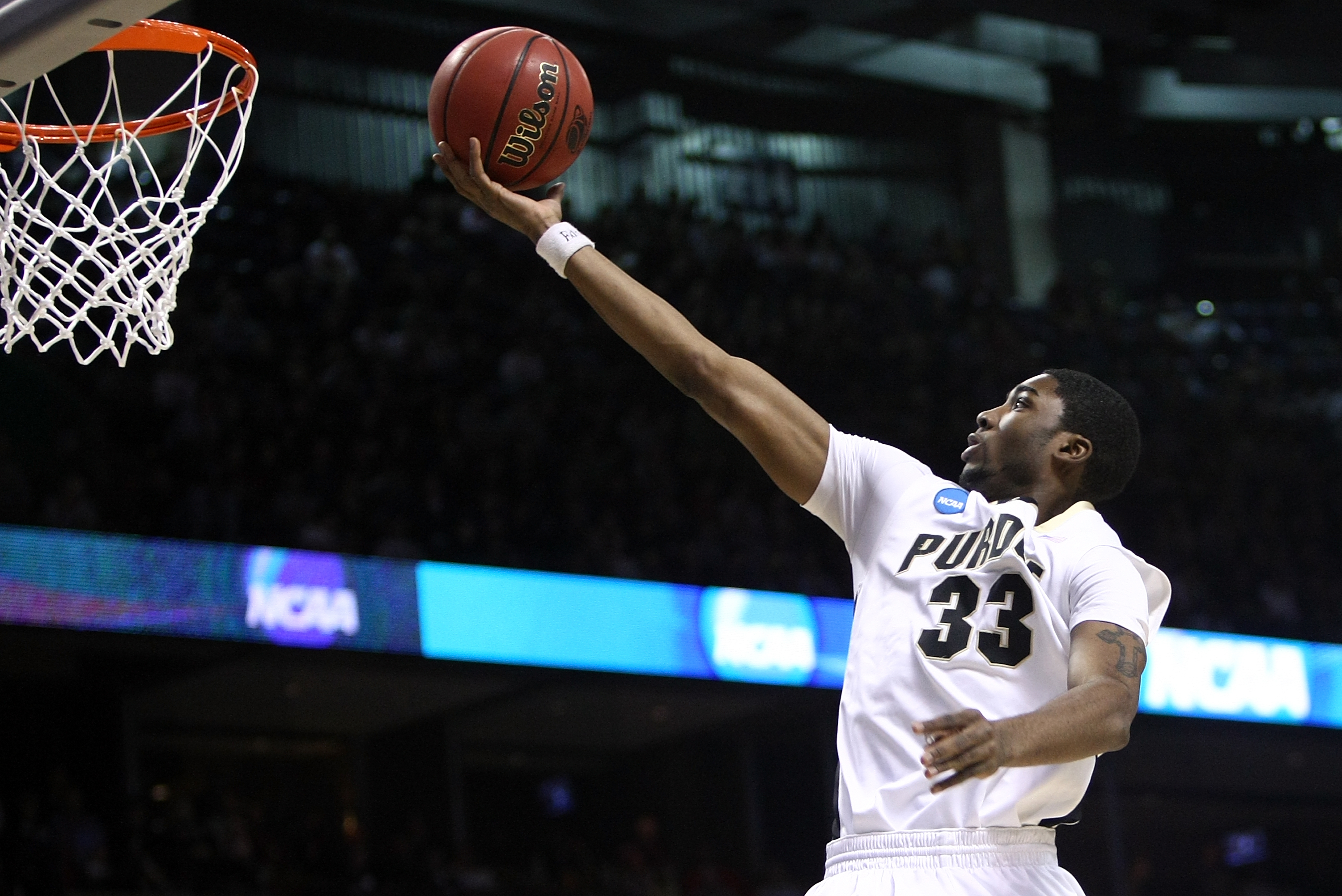 SPOKANE, WA - MARCH 21:  E'Twaun Moore #33 of the Purdue Boilermakers lays up the ball against the Texas A&M Aggies for the ball during the second round of the 2010 NCAA men's basketball tournament at Spokane Arena on March 21, 2010 in Spokane, Washington