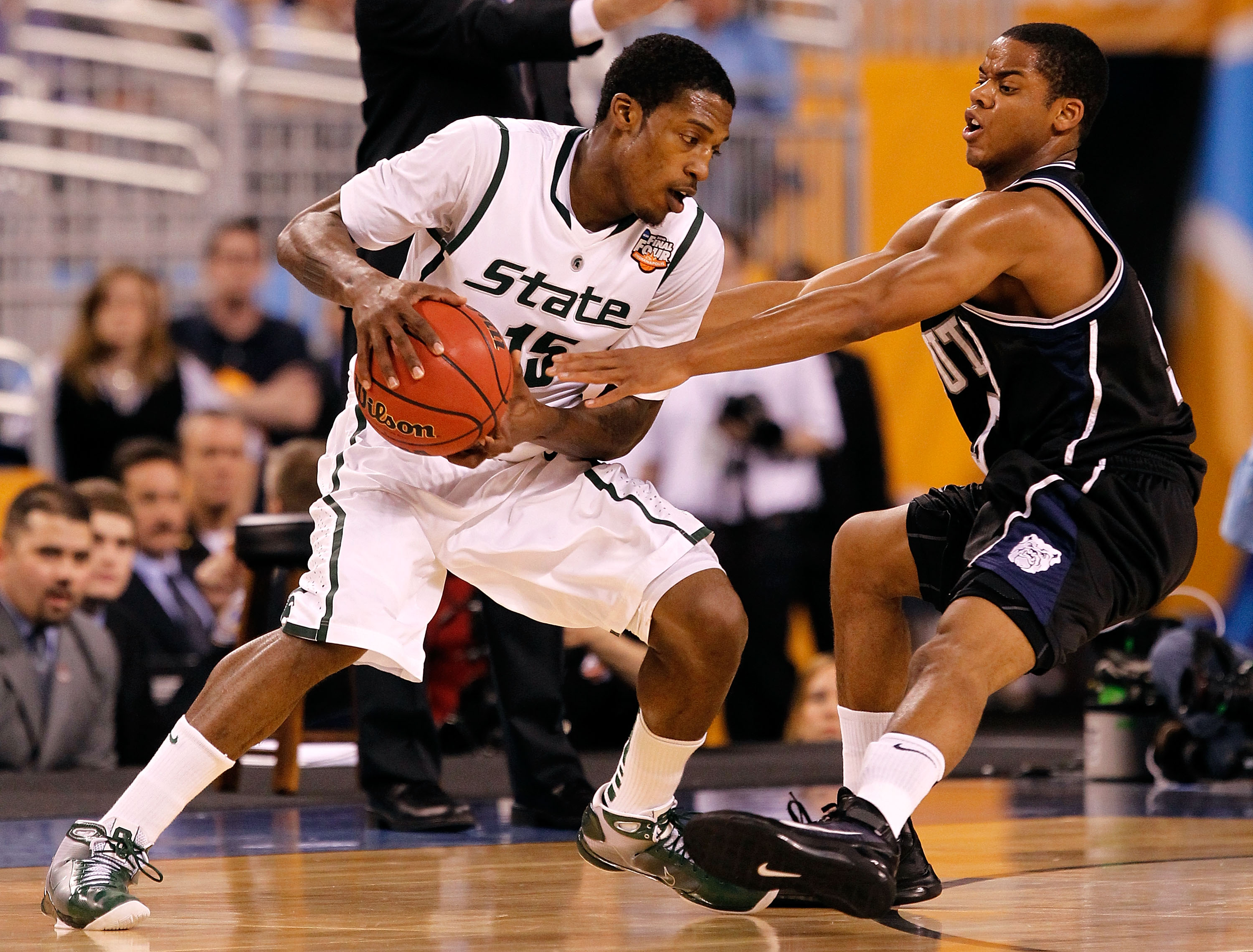 INDIANAPOLIS - APRIL 03:  Durrell Summers #15 of the Michigan State Spartans looks to drive against Ronald Nored #5 of the Butler Bulldogs during the National Semifinal game of the 2010 NCAA Division I Men's Basketball Championship on April 3, 2010 in Ind
