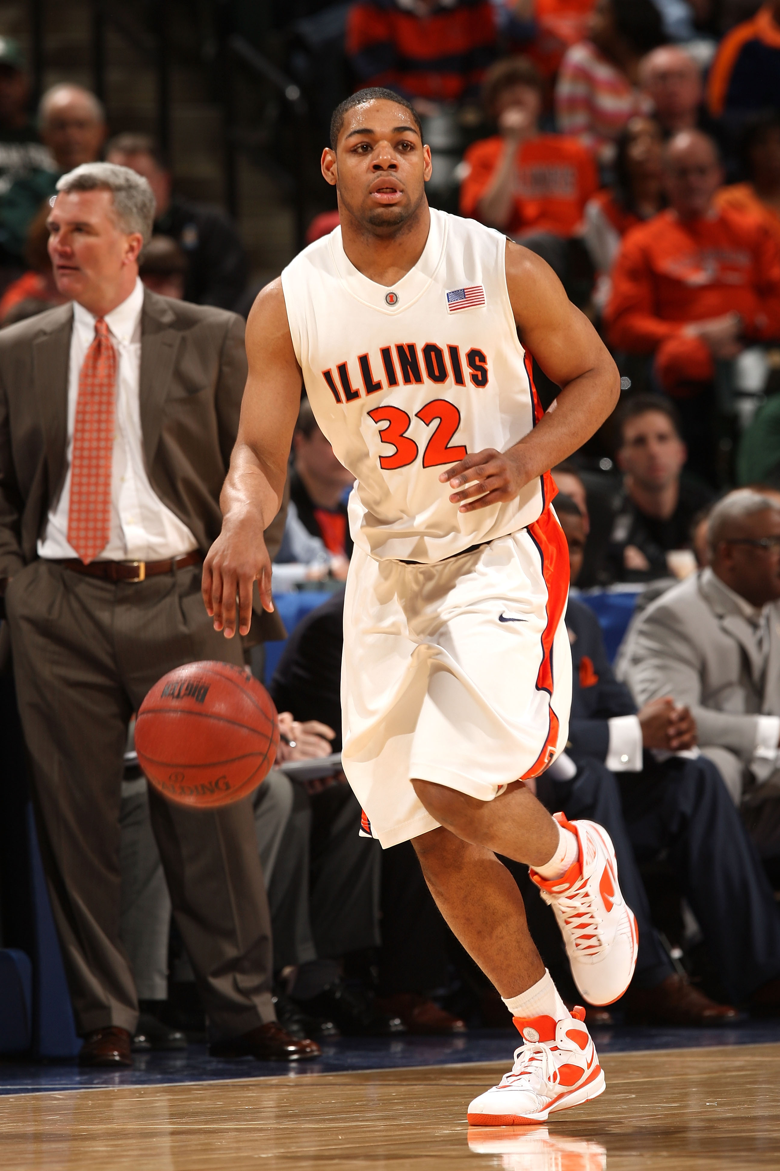 INDIANAPOLIS - MARCH 13:  Demetri McCamey #32 of the Illinois Fighting Illini brings the ball up court against the Michigan Wolverines during the second round of the Big Ten Men's Basketball Tournament at Conseco Fieldhouse on March 13, 2009 in Indianapol