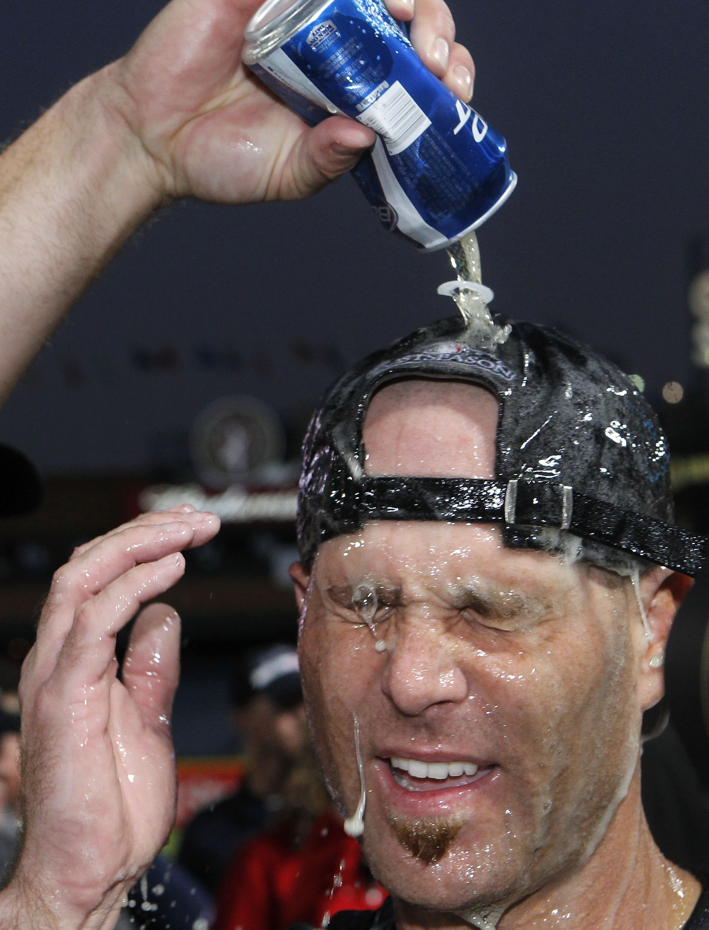 ATLANTA - OCTOBER 03:  Pitcher Tim Hudson #15 of the Atlanta Braves is doused by beer during the on-field playoff celebration after the game against the Philadelphia Phillies at Turner Field on October 3, 2010 in Atlanta, Georgia.  The Braves beat the Phi